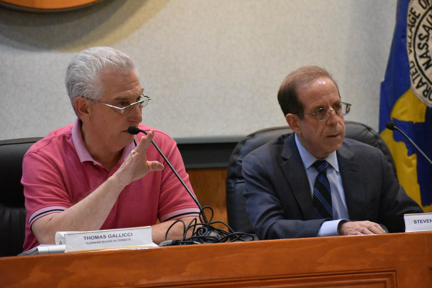 Thomas Gallucci, the Planning Board's acting chairman, left, alongside attorney Steven Leventhal, responded to a resident during a meeting on June 19.