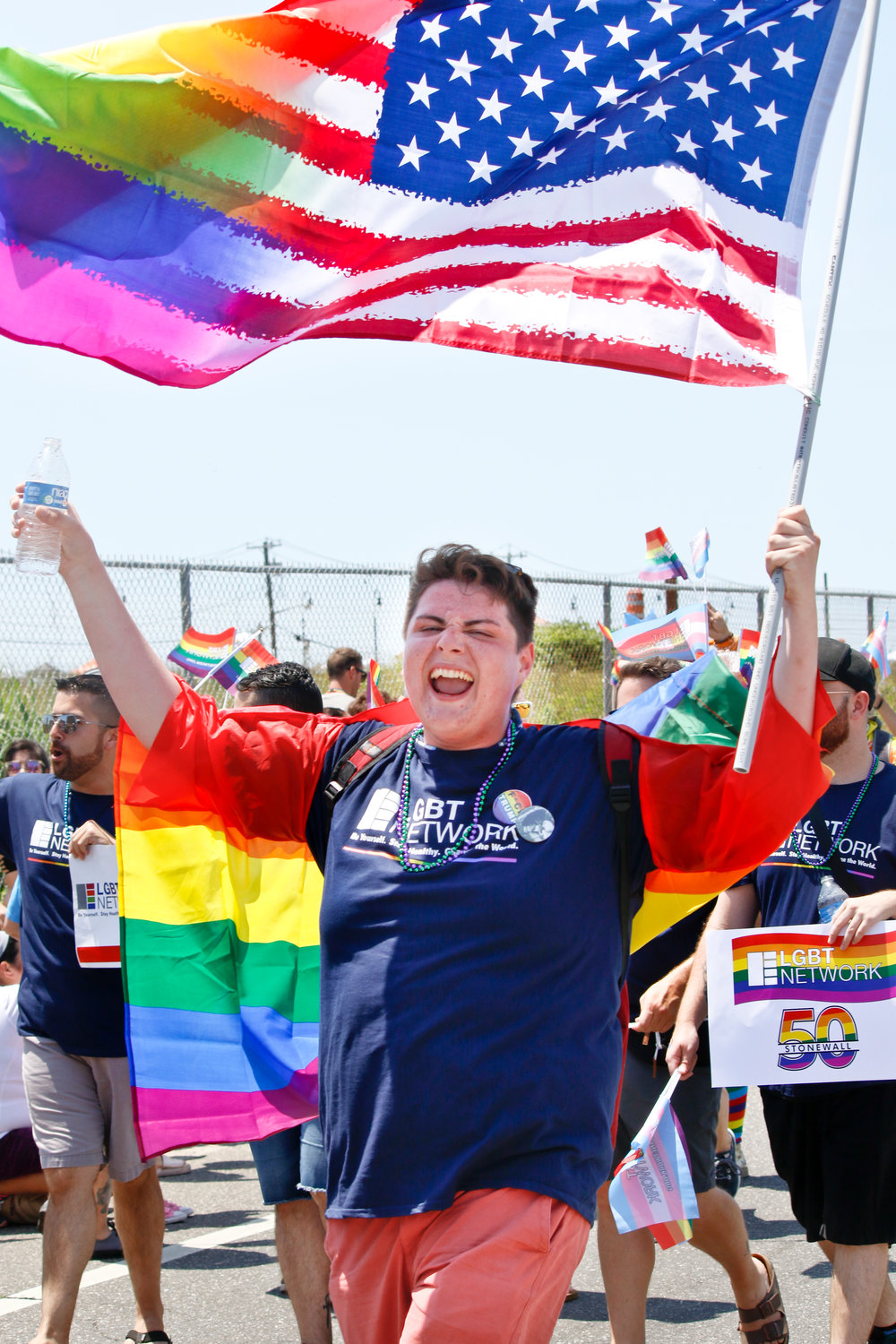 Long Beach High School student Joseph Carrasco, who will be starting his senior year in the fall, cheered with his fellow classmates during the annual Pride on the beach Parade.