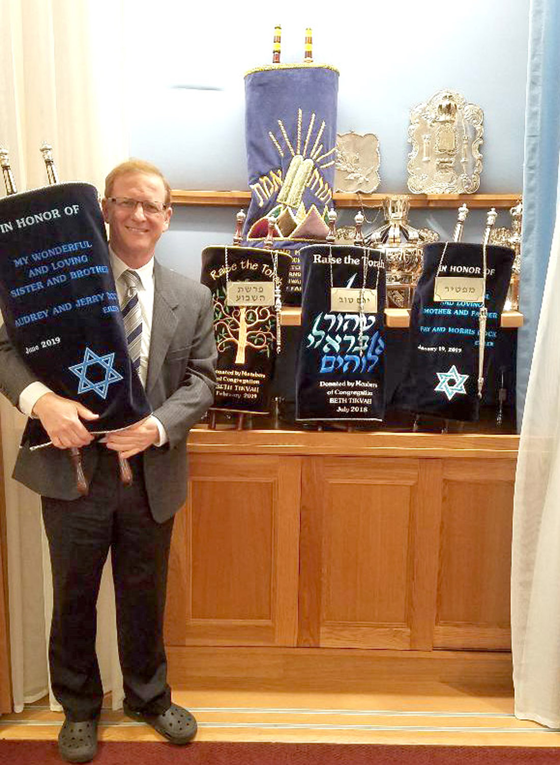 Rabbi Moshe Weisblum and his congregation celebrated the dedication of Congregation Beth Tikvah's fourth new Torah on June 9.
