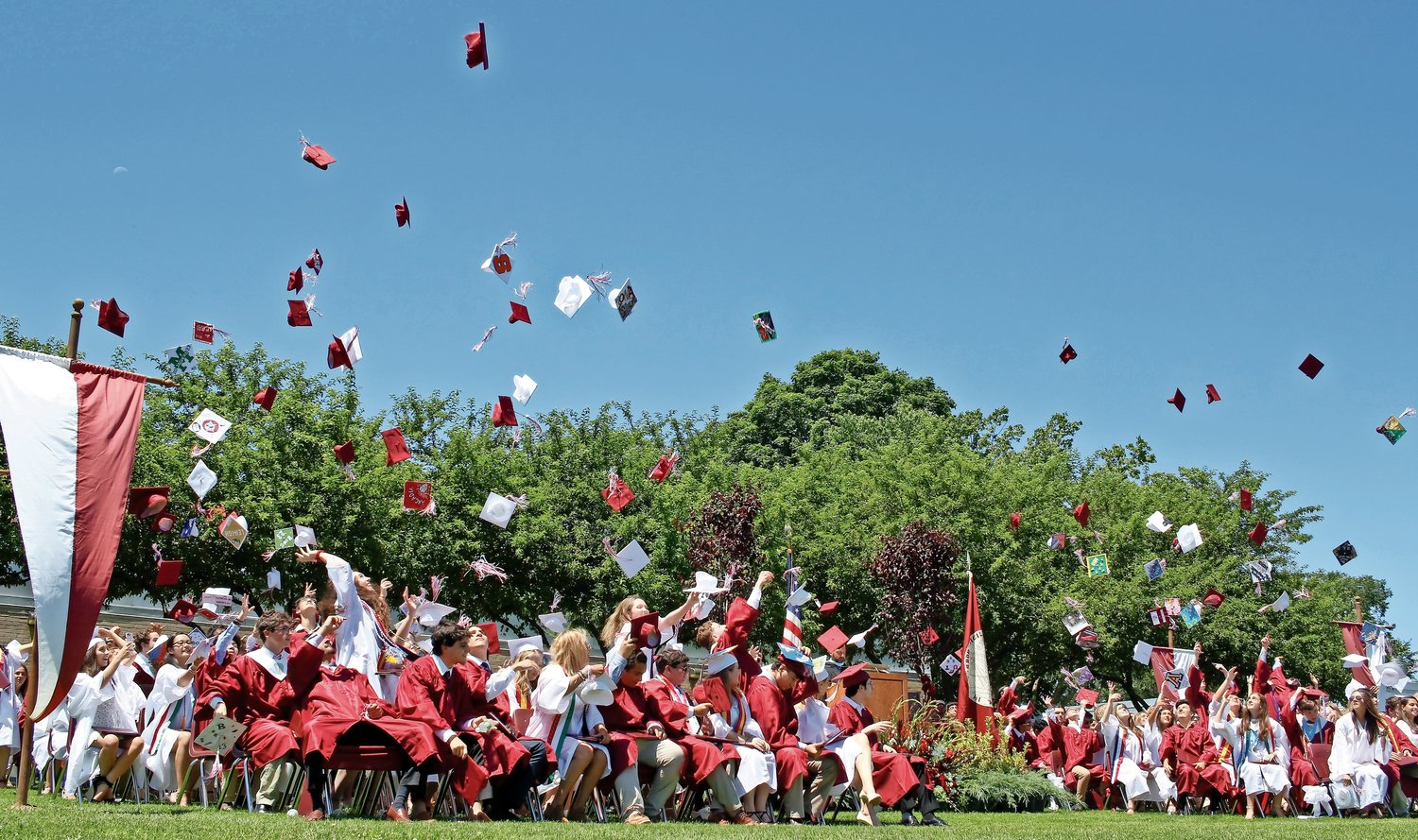 After they moved their tassels across their mortarboards, North Shore High's latest graduating class tossed their caps in the air, creating a cascade of maroon and white.