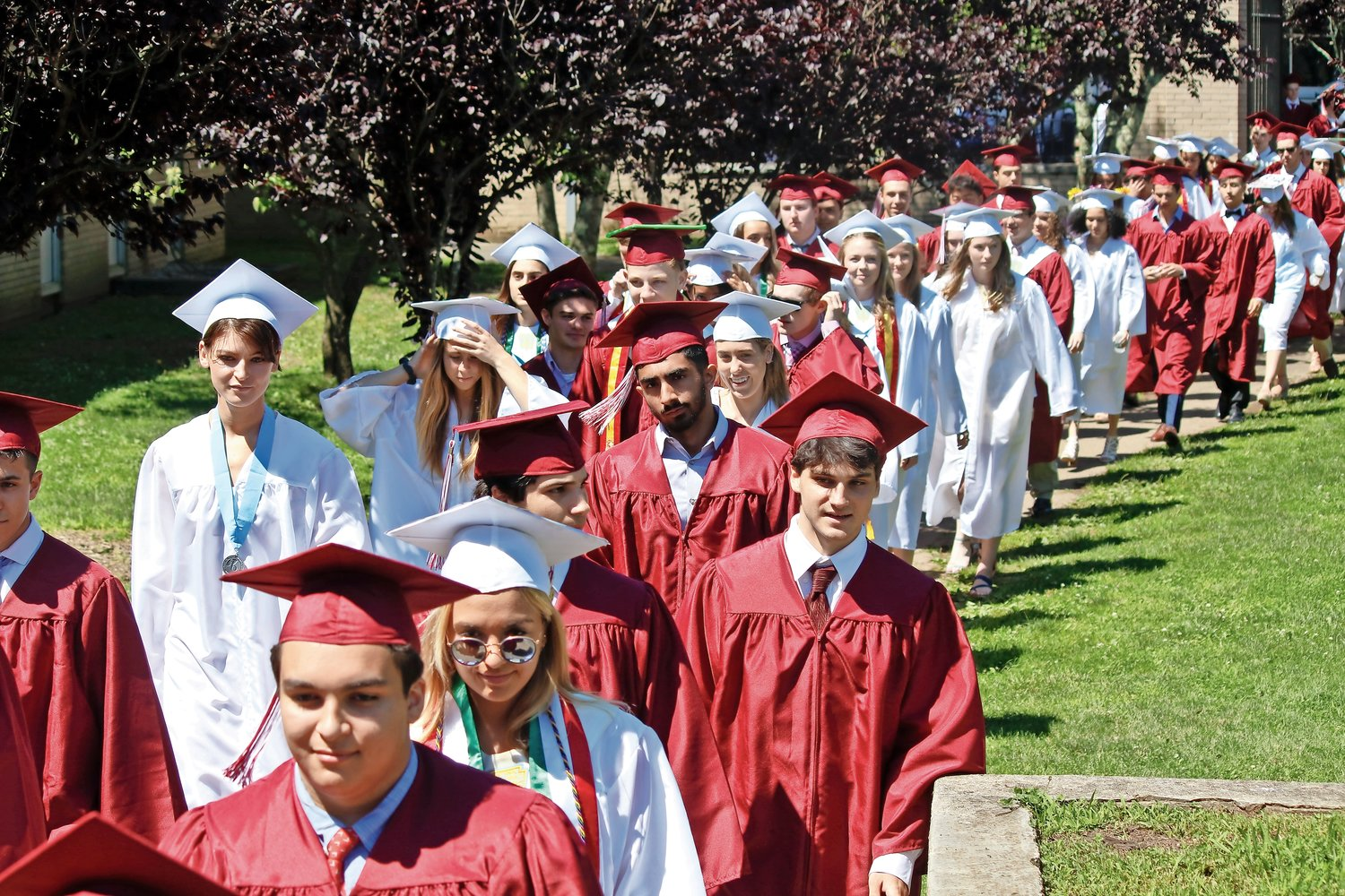 The North Shore High School class of 2019 filed in from the courtyard to begin commencement exercises.