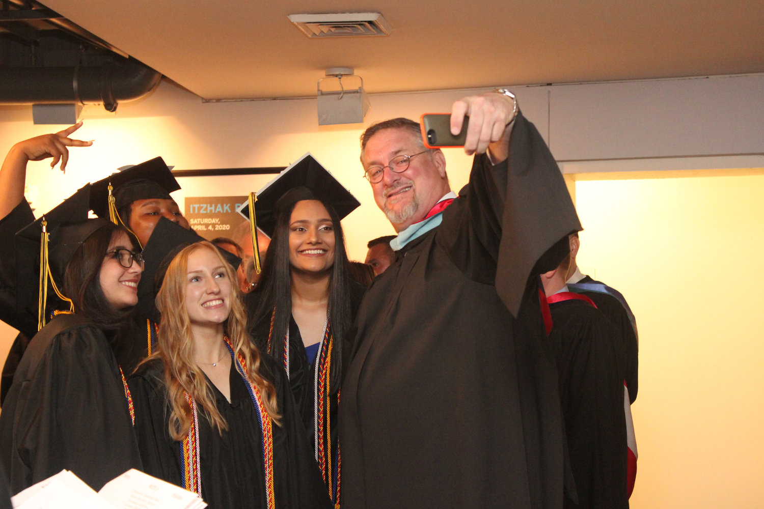 West Hempstead Schools Superintendent Daniel Rehman with, from left, Valedictorian Marisa Sheehan, senior class Co-president Autumn Collins, Salutatorian Isabella Caldwell and Co-president Harpinder Kaur before graduation last Sunday at LIU Post.