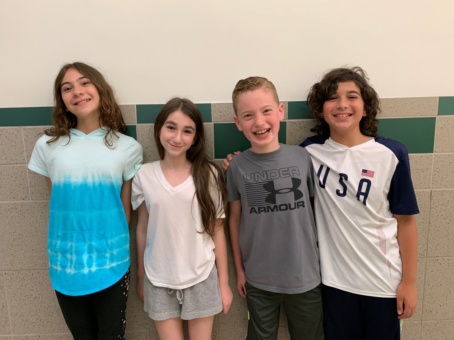 Hewlett Elementary School's Team BLEM finished first out of 267 teams on Long Island in a stock market game sponsored by the Security Industry and Financial Markets Association. From left were fifth-graders Madison Miley, Hailey Erdos, Daniel Baum and Ryan Leguillow.