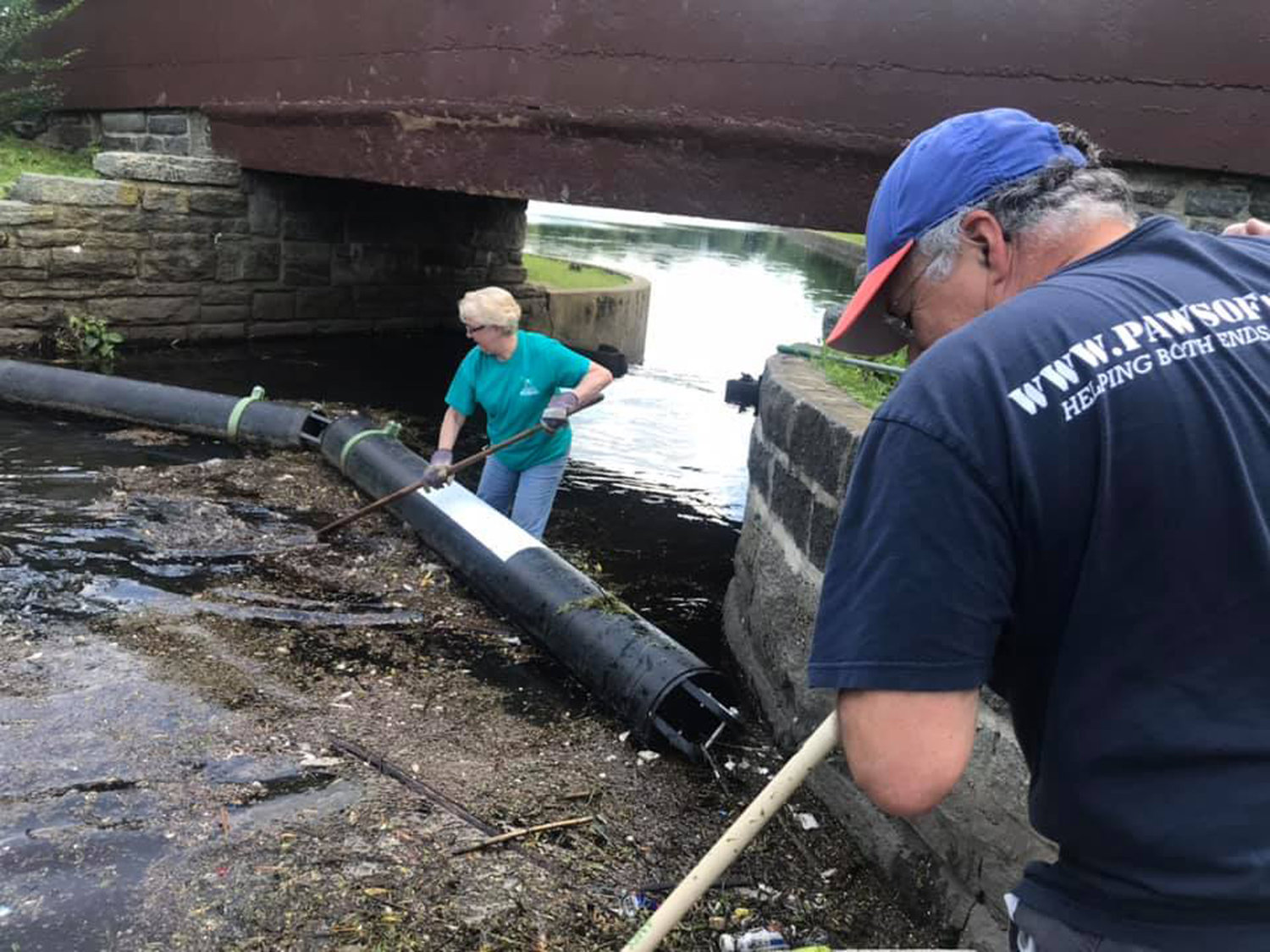 Patricia and Mike Russo cleaned the lake at the Arthur J. Hendrickson Park on June 22.
