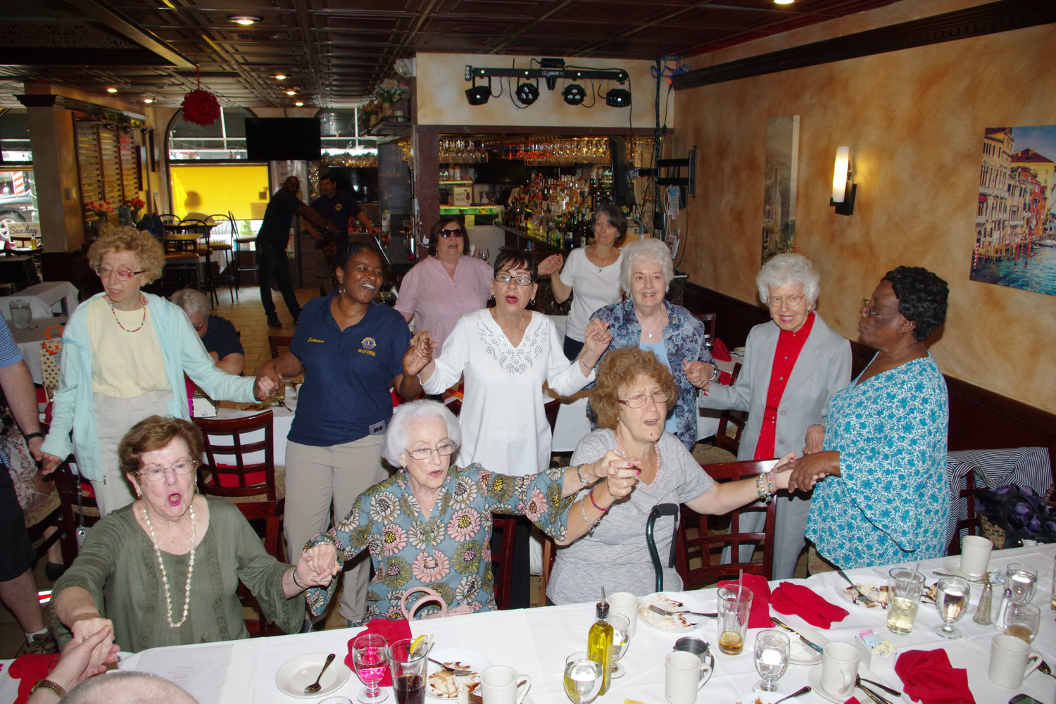 "Attendees at the Lion's annual VIP Luncheon linked hands and sang Dionne Warwick's ""That's What Friends are For."""