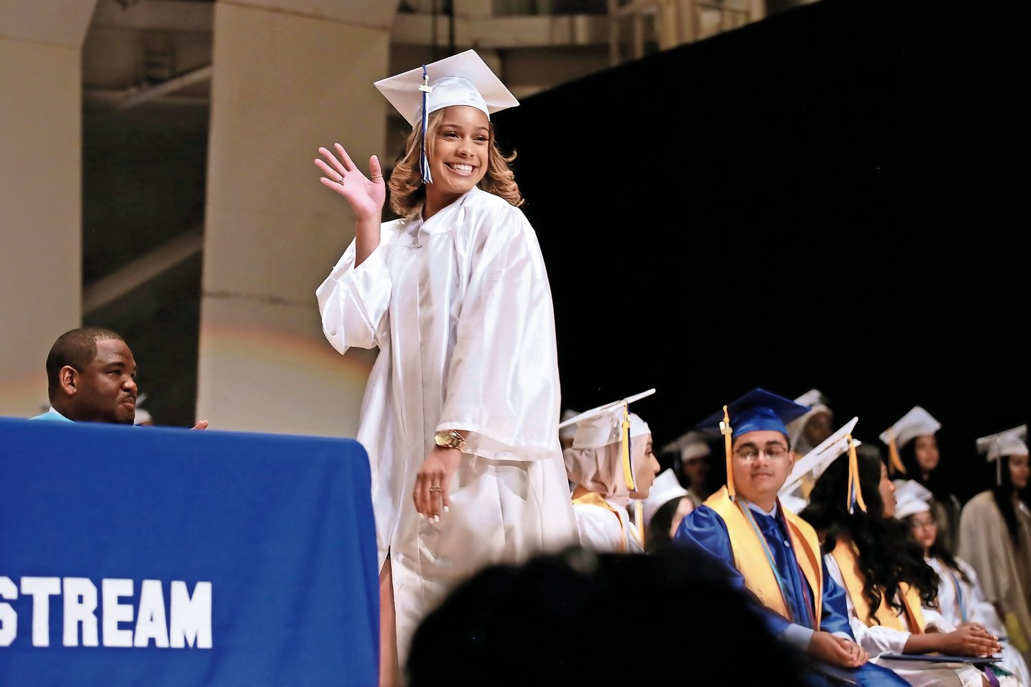 Valerie Ruiz smiled and waved as she walked across the stage of the Tilles Center.