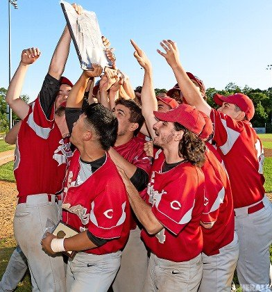 Clarke hoisted the Nassau Class A baseball championship plaque after defeating Division in the best-of-three finals.