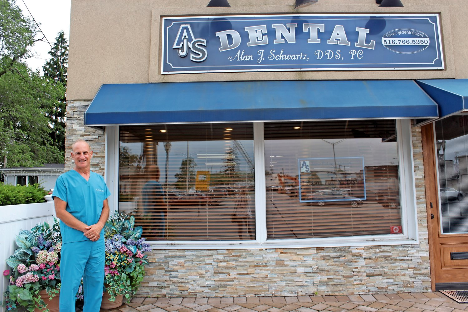 Alan Schwartz, a 1976 Oceanside High School graduate, has practiced dentistry in the hamlet for 10 years.