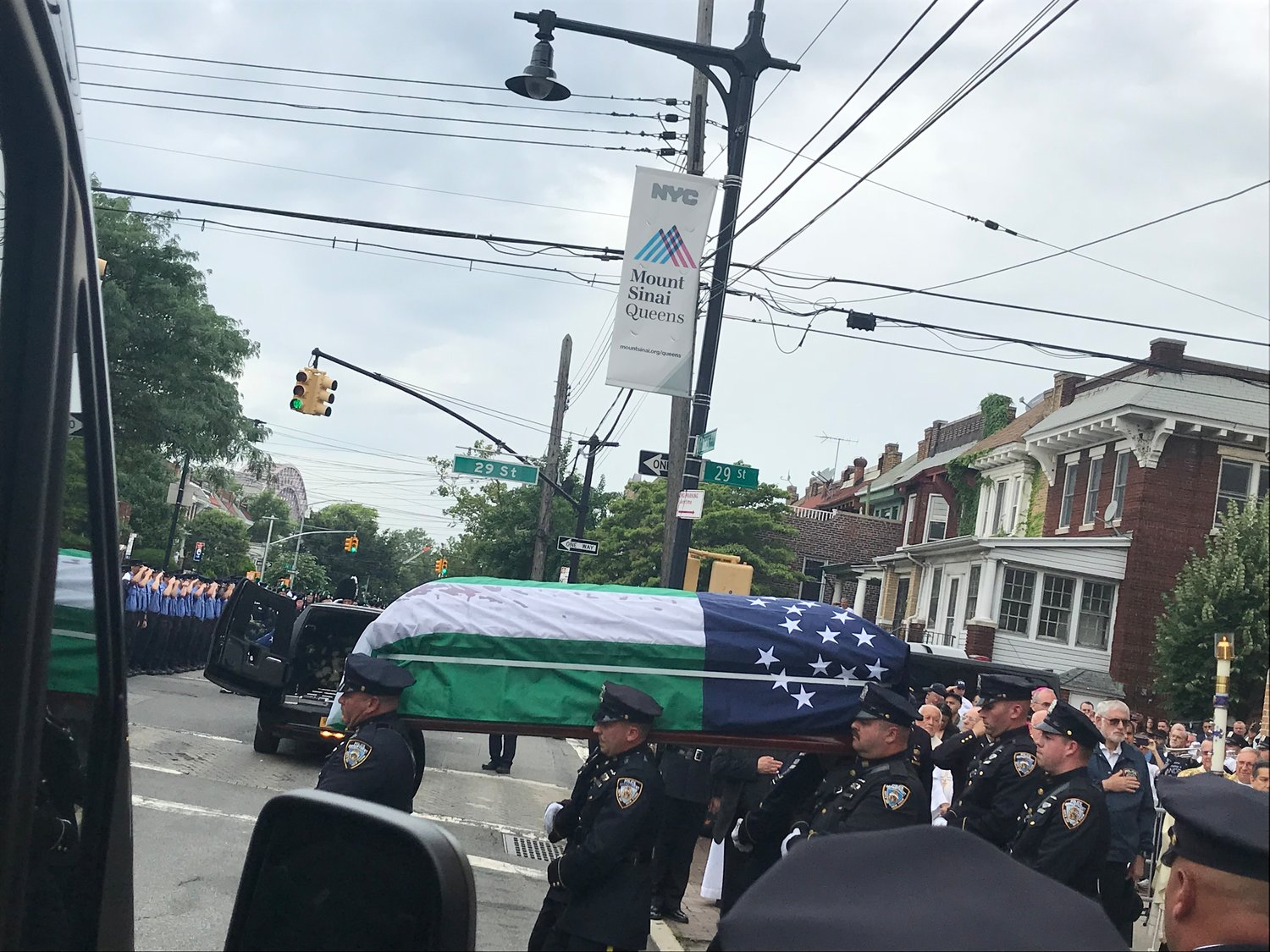 Officers readied to place Alvarez's casket into an awaiting hearse.