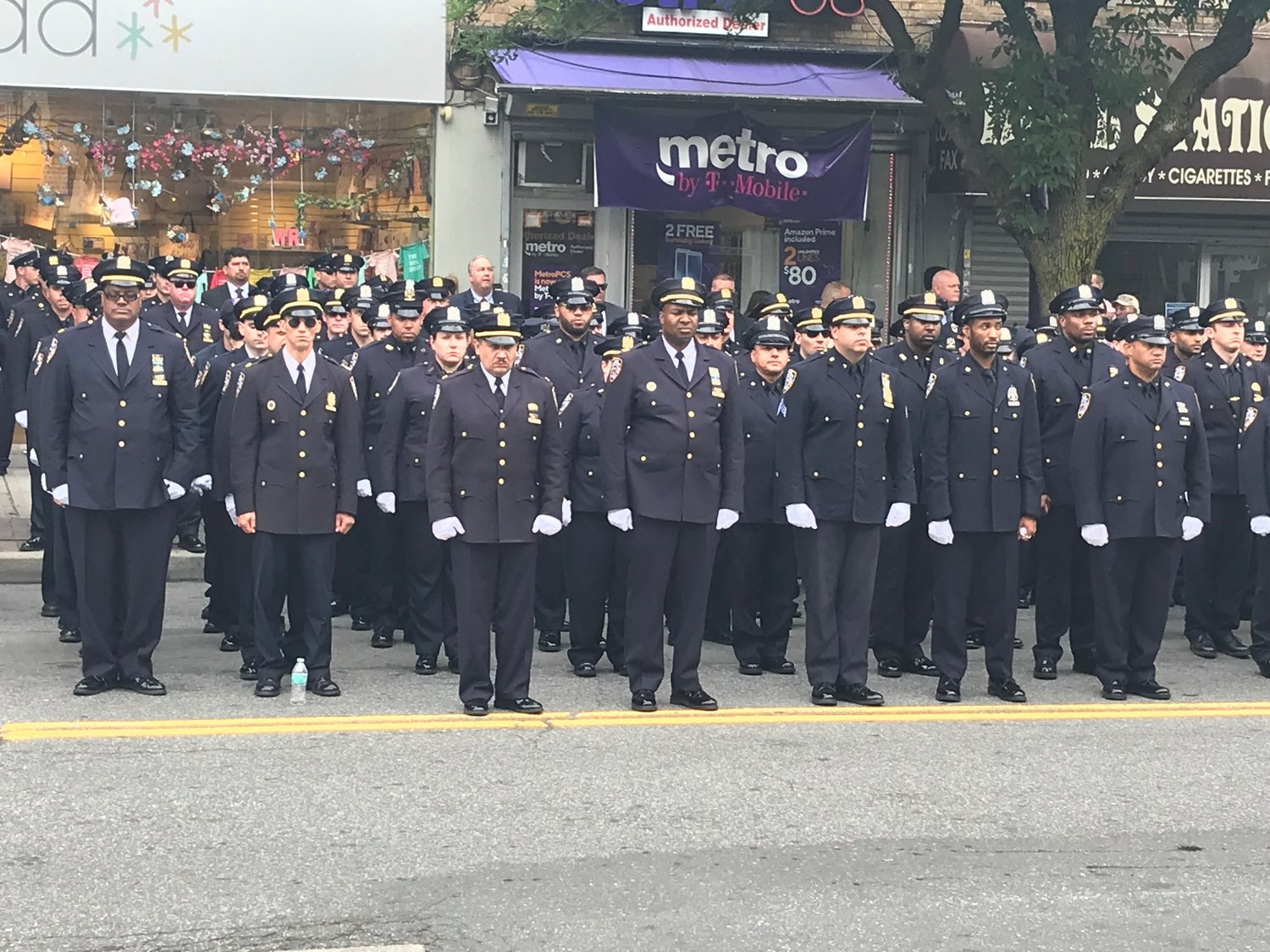 Police lined Ditmars Boulevard outside of the church and stood at attention.