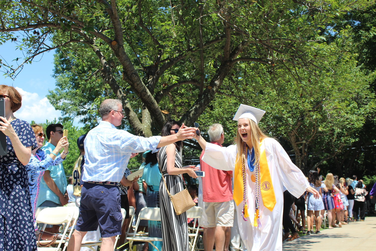 Lauren Jones received a high five as she made her way to the front of Oyster Bay High School.