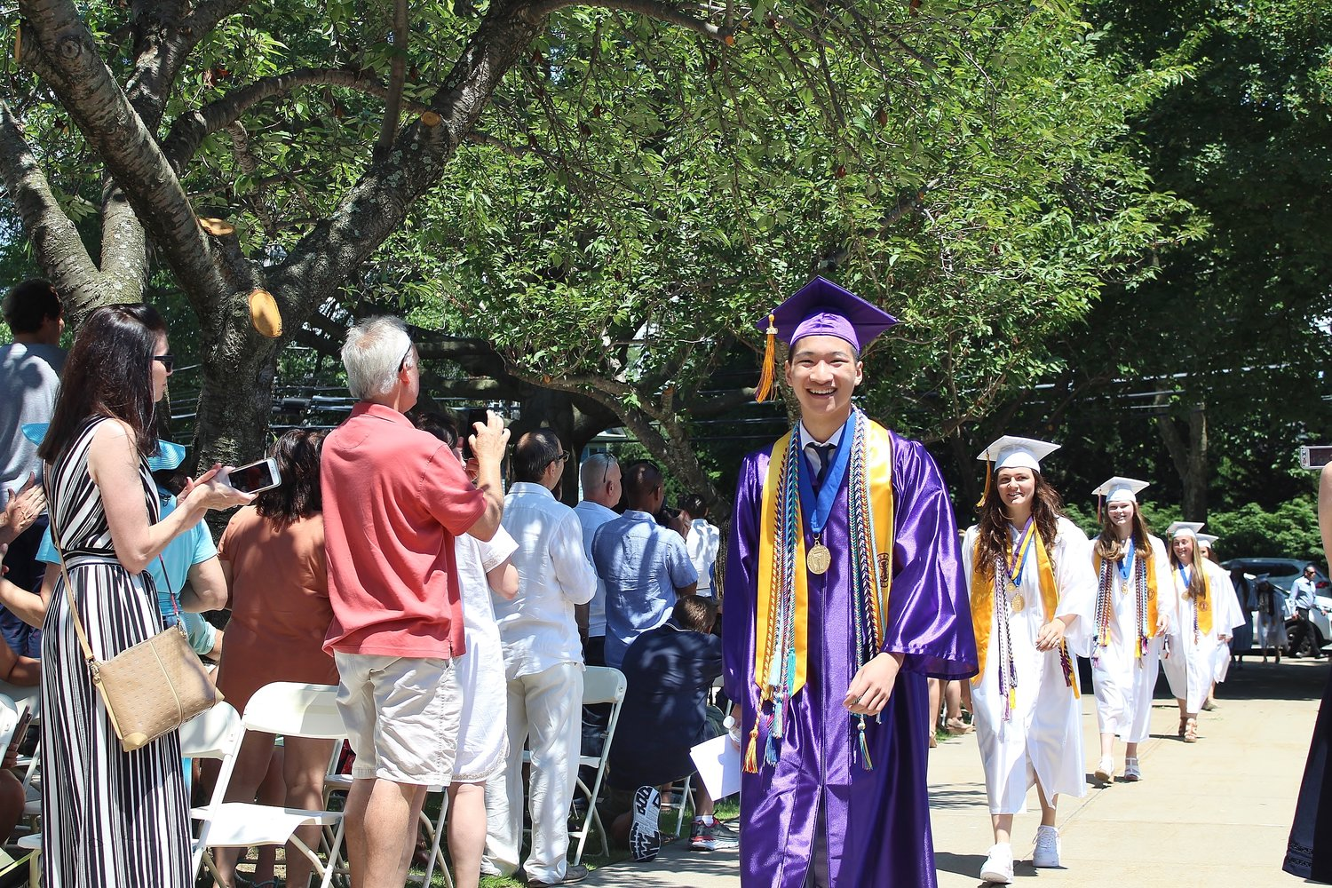 It was a big day for valedictorian Jason Hom who led the graduation procession.