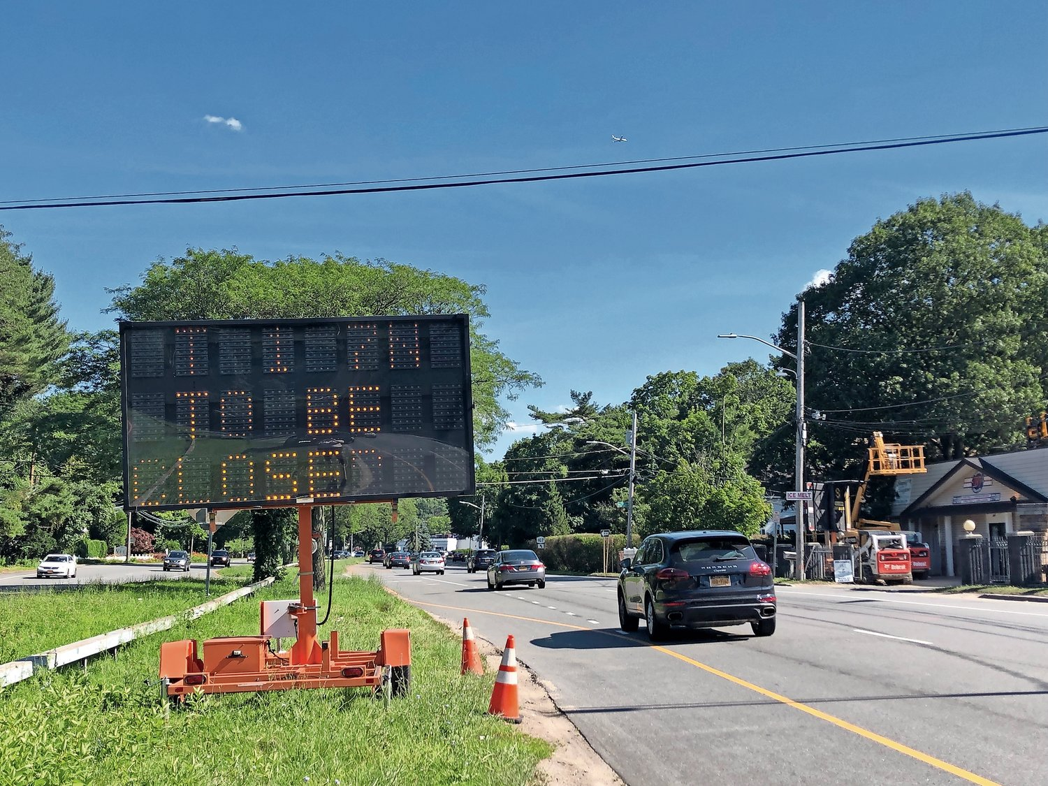 A sign along Route 107 in Glen Head indicates that the roadway will soon be closed for utility work in some places.