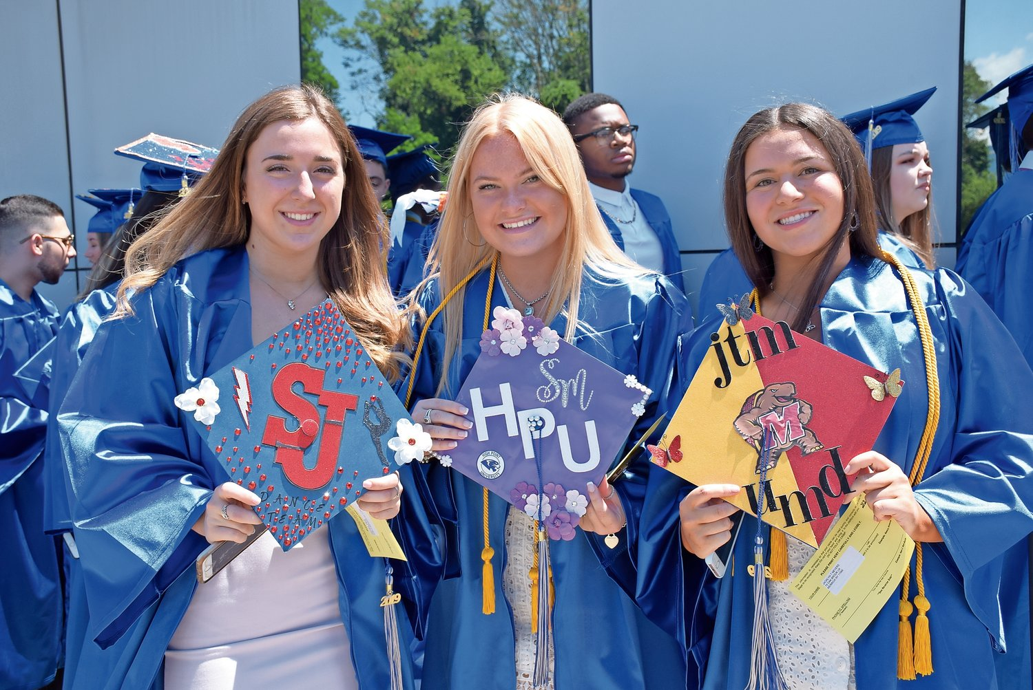 Sanford H. Calhoun graduates, from left, Amanda Mele, Sydney McGinley and Jacklyn Meyers showed off their future universities.