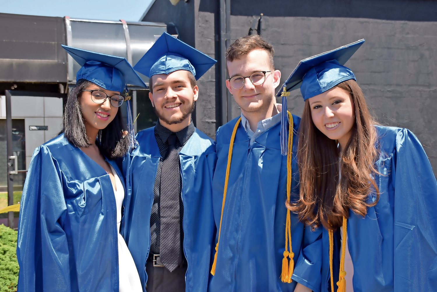 Outside of the NYCB Theatre, graduates were teeming with excitement. From left are Arianny Garcia, Victor Gavilanes, Thomas Giobardo and Isabella Goldberg.