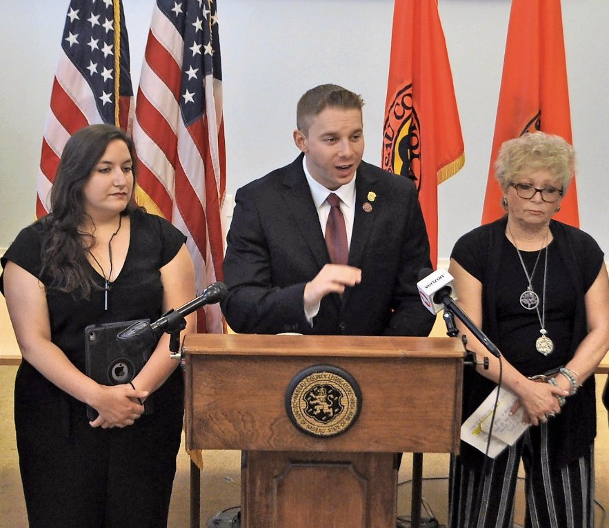 County Legislator Josh Lafazan, with Leah McCloskey, left, and Marta Reeger, of Mill Neck Services, announced his new bill at a news conference on June 18.