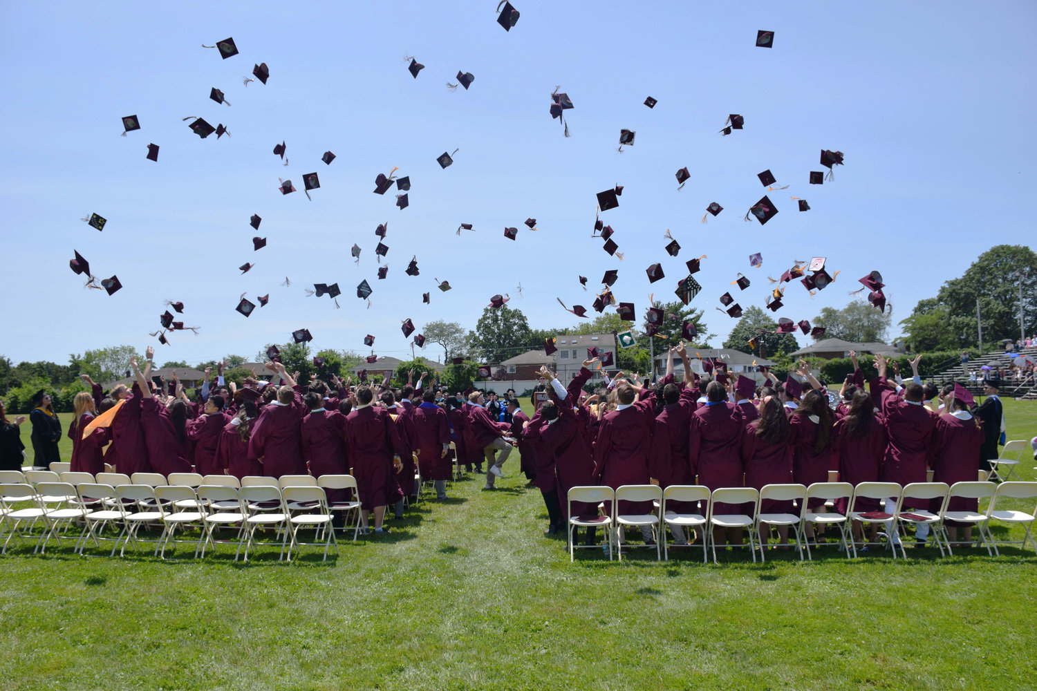 W.T. Clarke students celebrated before racing to friends and family watching the graduation ceremony on the field of the Leon J. Campo Salisbury Center in Salisbury.