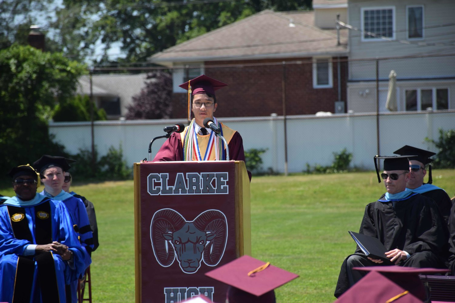 Valedictorian Jonathan Melkun addressed his peers at W.T. Clarke High School during its graduation ceremony on June 23.