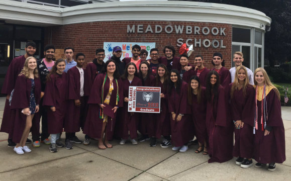 Some W.T. Clarke seniors posed in front of Meadowbrook Elementary School, from which they graduated seven years ago.
