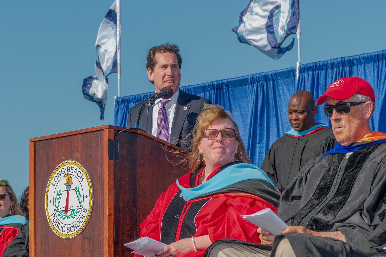 "State Sen. Todd Kaminsky, at left above, a Long Beach High graduate, told the class, ""Remember where you came from, do not take crap from anyone, and go Beach!"""