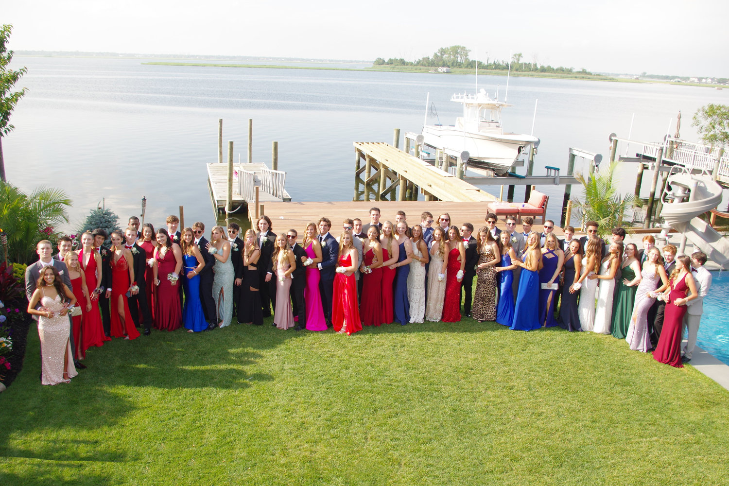 The students lined up for group shot at the home of classmate Caleb Monzon before heading to the prom at Chateau Briand in Westbury.