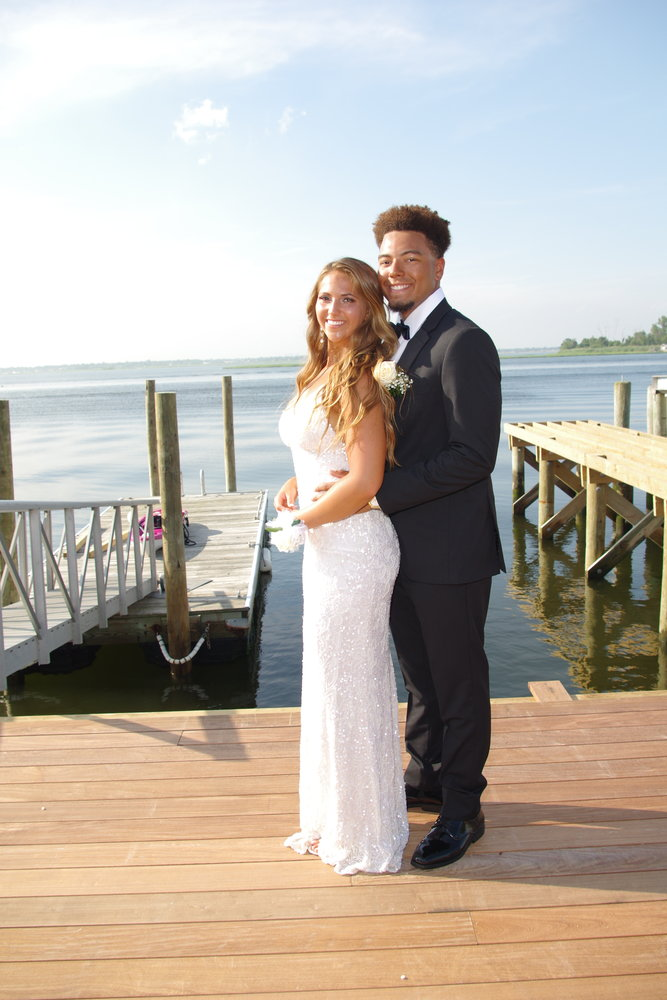 Daisy Willard and her date, Alex Ramirez posed by the water.