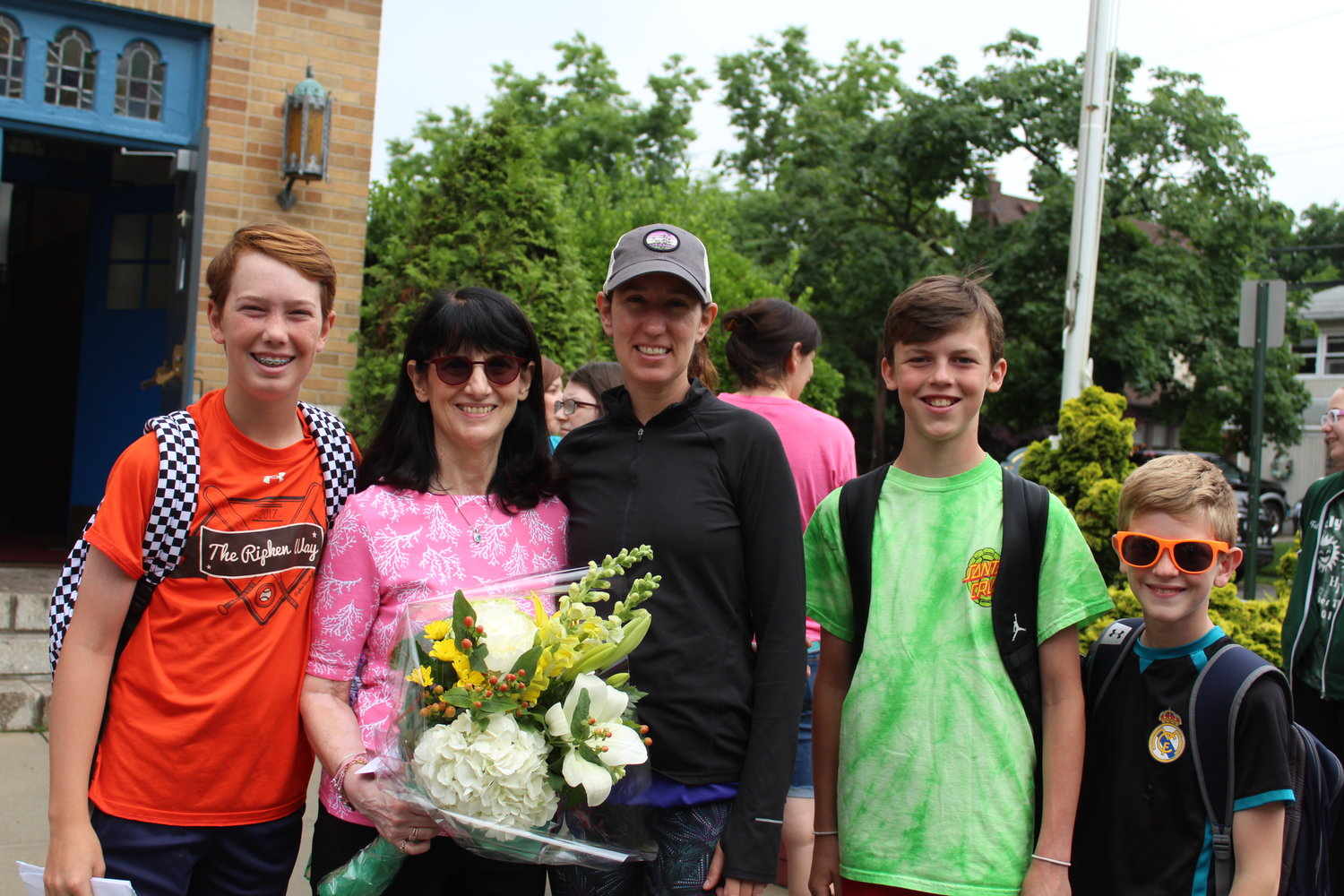 Murphy, second from left, above, was recognized on her last day of school by students and staff members including John Murray, far left, school board President Monica Coffey-Murray, Patrick Carew and Tommy Baldacchino.