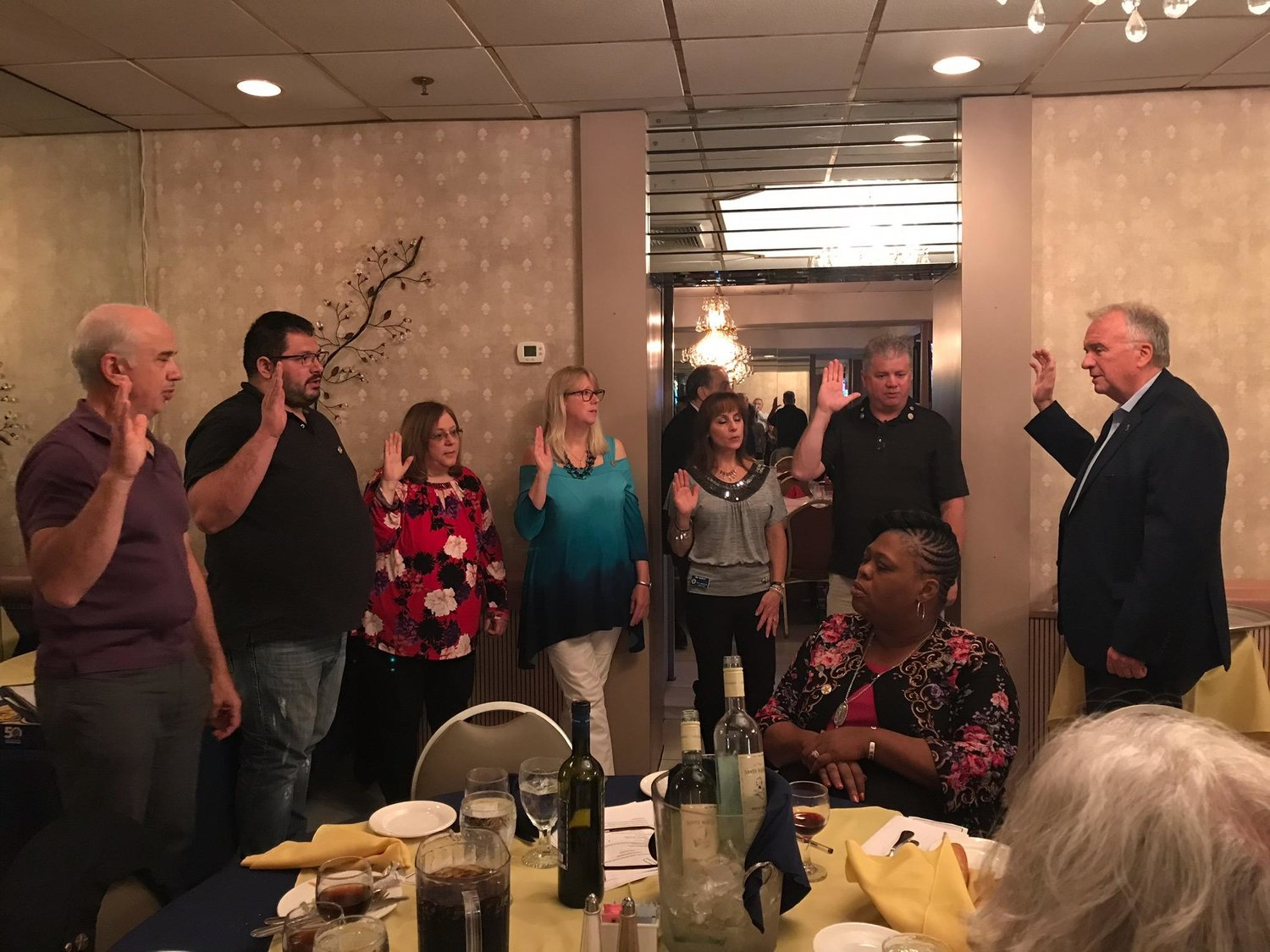 West Hempstead Lions Club President Frank Parise, far left, first Vice President Steven Oster; Secretary Tonie Jean-Louis; Treasurer Sue Reichert; Tail Twister Mia Murphy and Lion Tamer Joe Murphy were sworn in by Past International President Al Brandel last month.