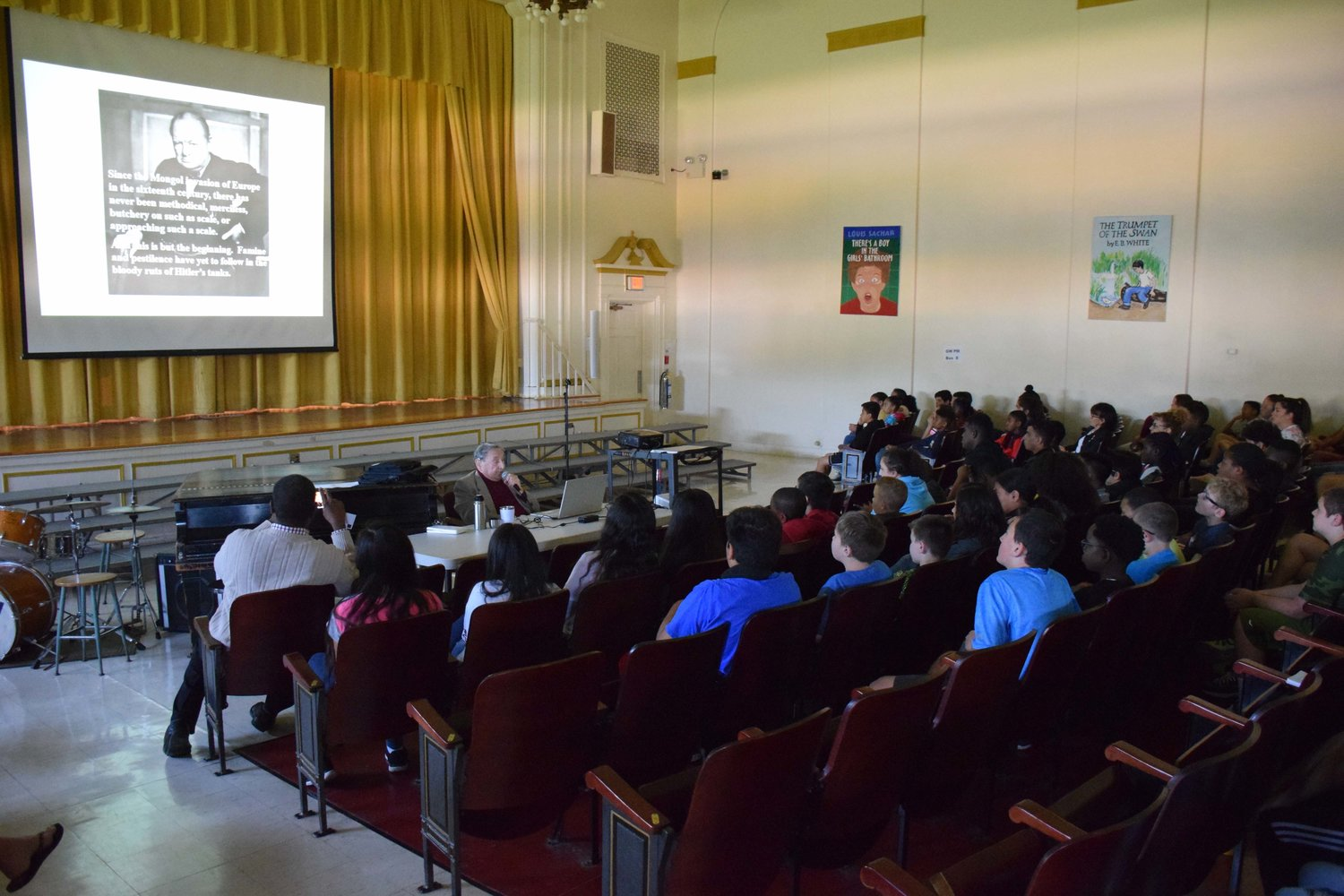 George Washington Elementary School sixth graders listened to a presentation from Holocaust survivor Werner Reich on June 4.