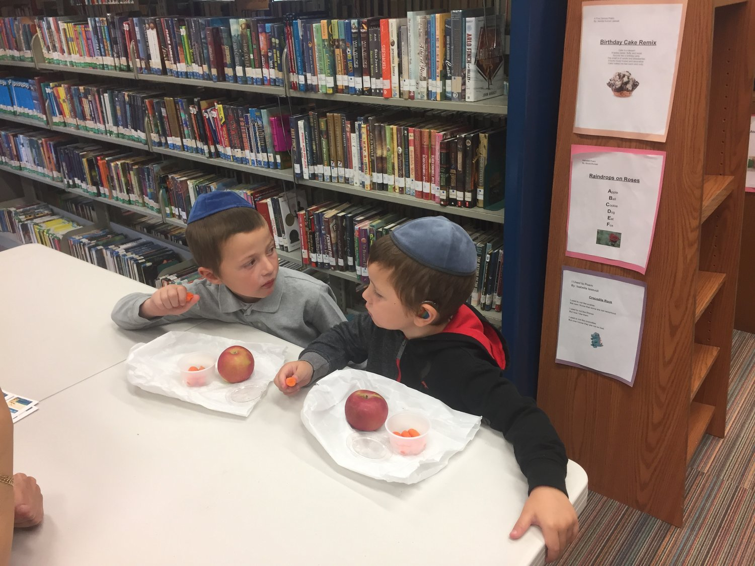 Y.Y. Polansky, left, and his younger brother, Tan, enjoyed their free food at the Peninsula Public Library on Monday.