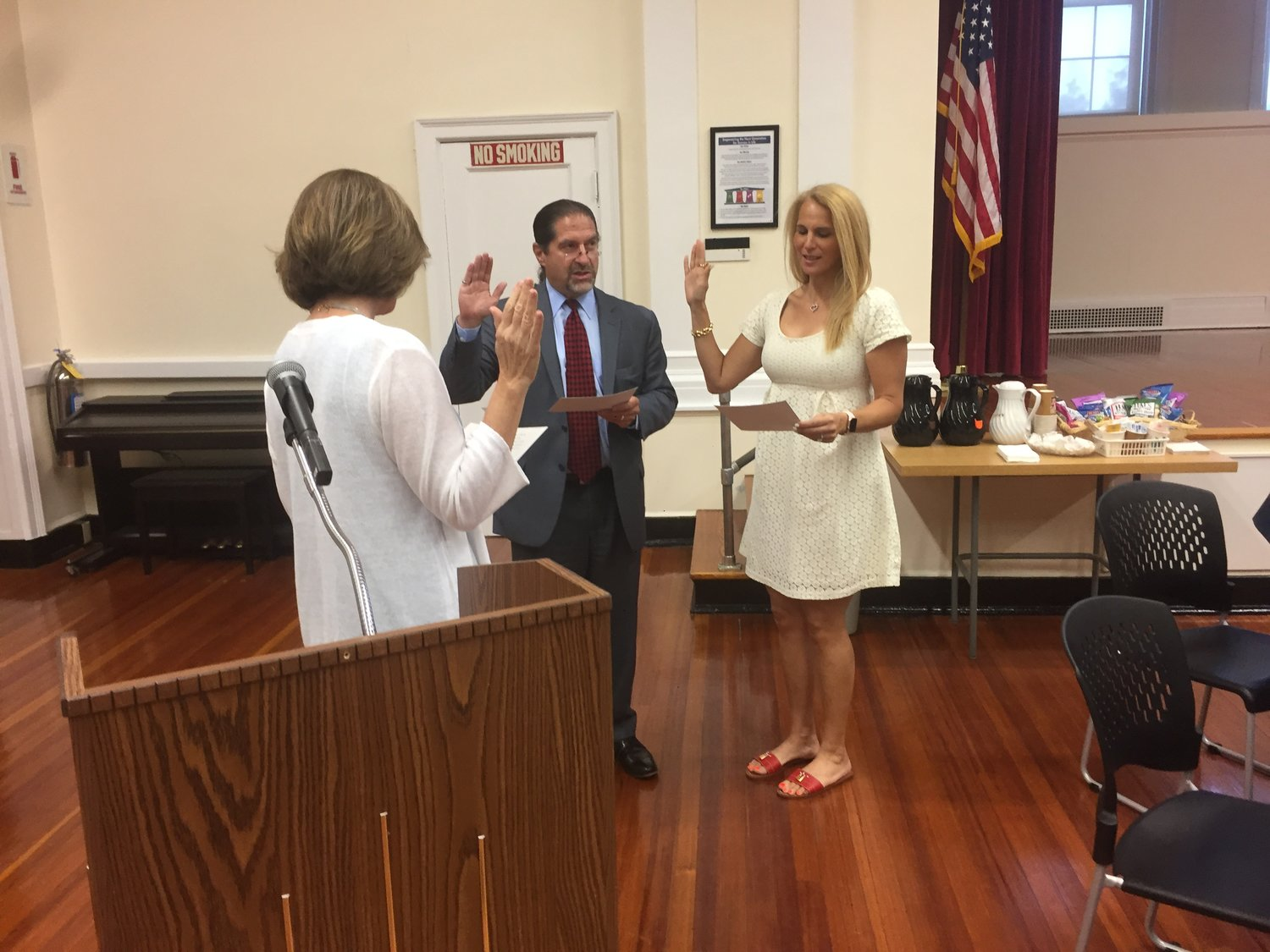 Hewlett-Woodmere Board of Education President Mitchell Greebel and Trustee Daniella Simon were sworn in for fresh three-year terms at the reorganization meeting on July 2.