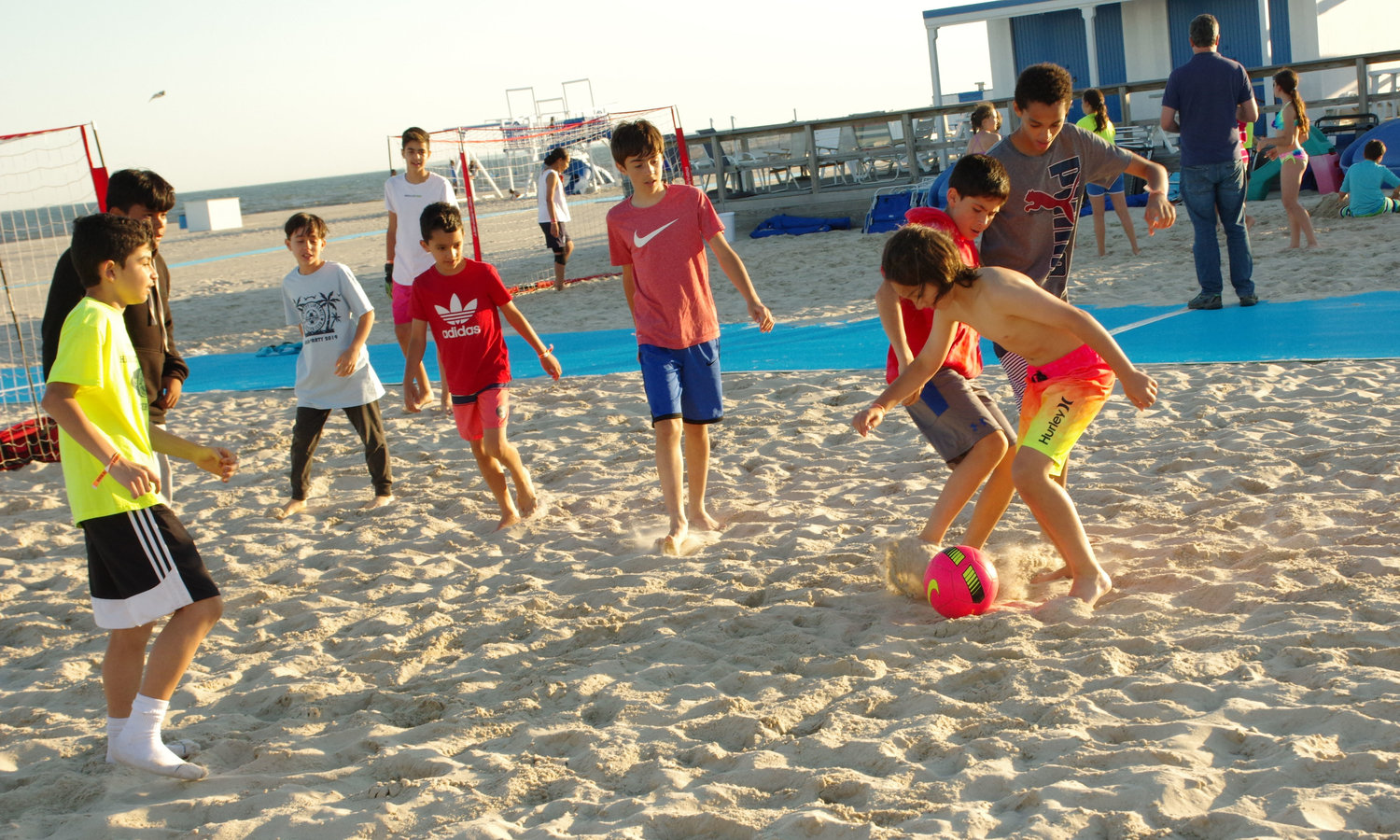 Hewlett Lawrence Soccer Club members combined the sand, soccer and sun at the annual party at the Sands Atlantic Beach on June 14.