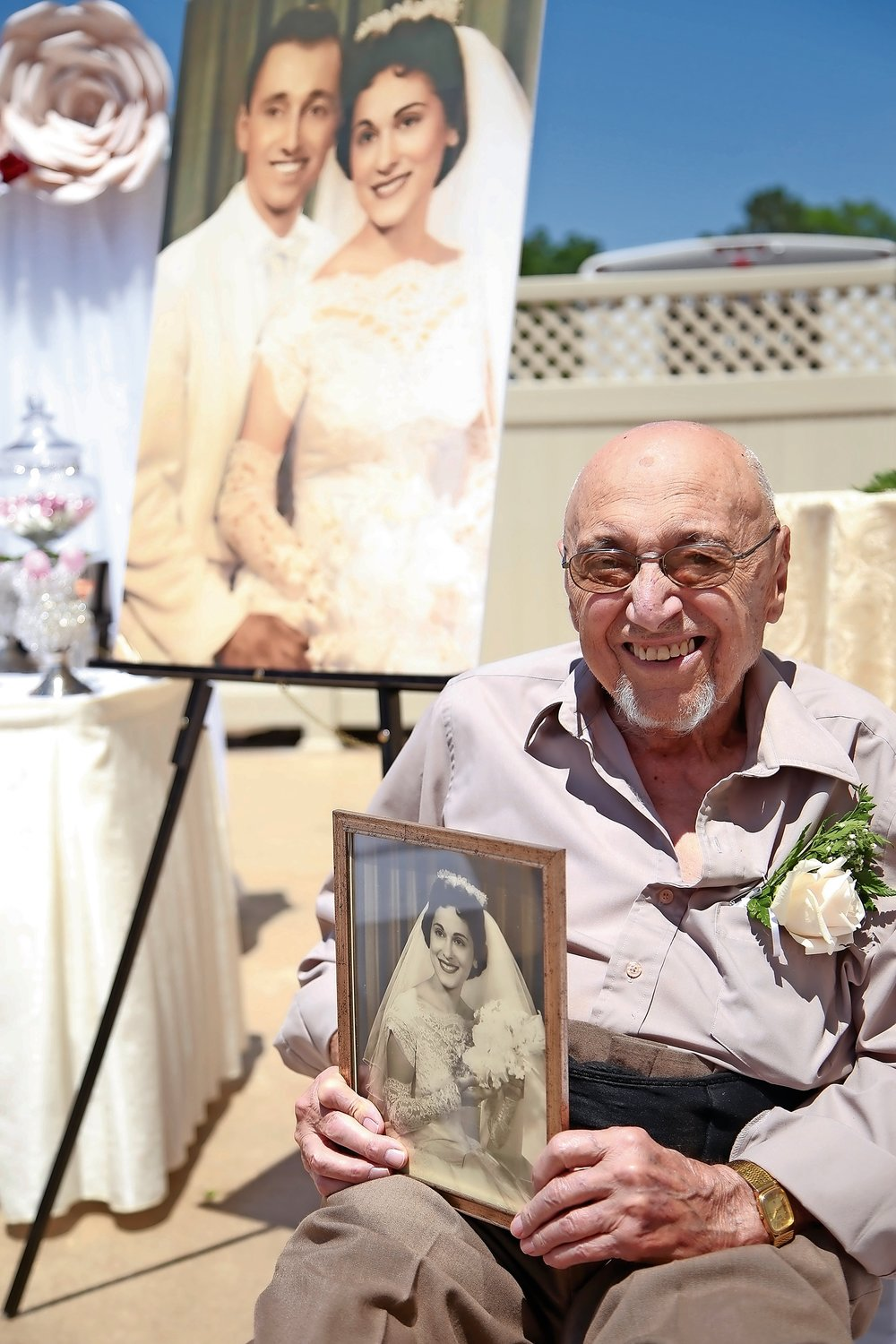 Although his wife, Eda, was unable to attend, Vincent DeMatteis brought along her photo.