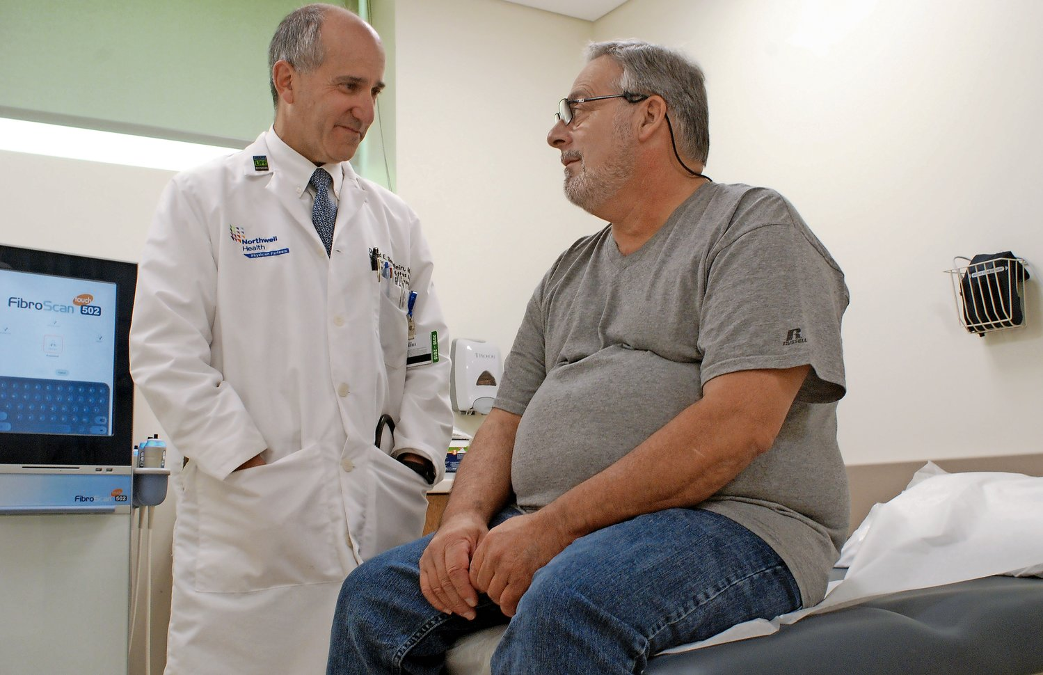Liver transplant patient George Conte, of Floral Park, consulted recently with Dr. David Bernstein, Northwell Health's chief of hepatology, at the Sandra Atlas Bass Center for Liver Diseases at North Shore University Hospital in Manhasset. Conte received a new liver last August, at Montefiore Hospital in the Bronx. Patients no longer need to leave Long Island for liver transplants now that Northwell offers them.