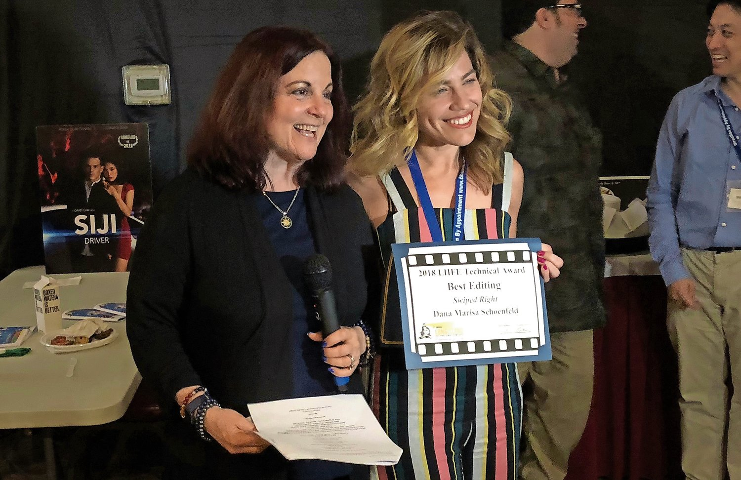 The presentation of technical awards during LIIFE's opening night is a tradition. Nassau County Film Office Director Debra Markowitz, far left, with Best Editing winner Dana Schoenfeld in 2018.