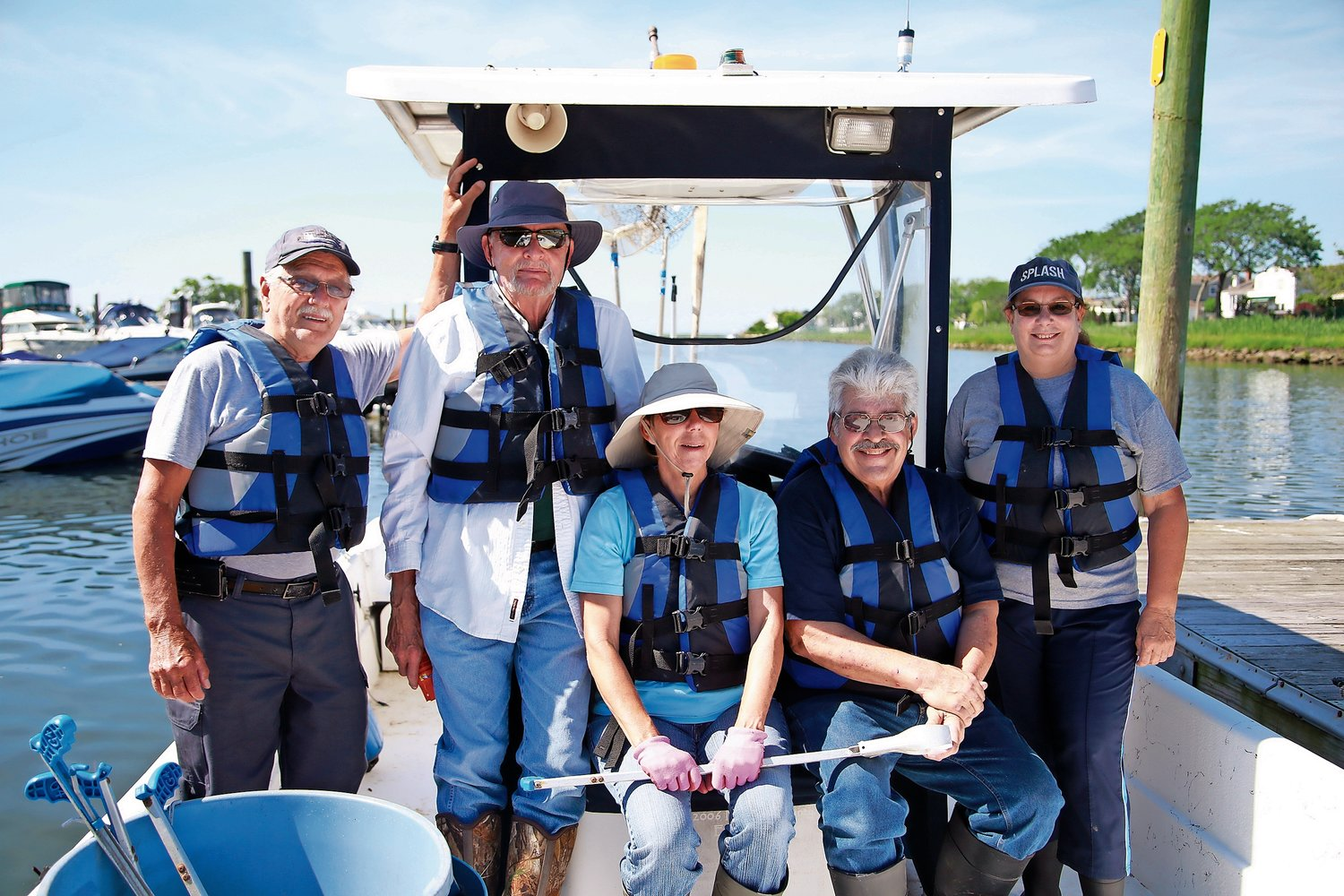 SPLASH volunteers Captain Jim Toporcer, Leo Smith, Sue Zieniewicz, Mike Cacioppo and Carolyn LaRosa patrolled Bellmore's waterways on June 27.