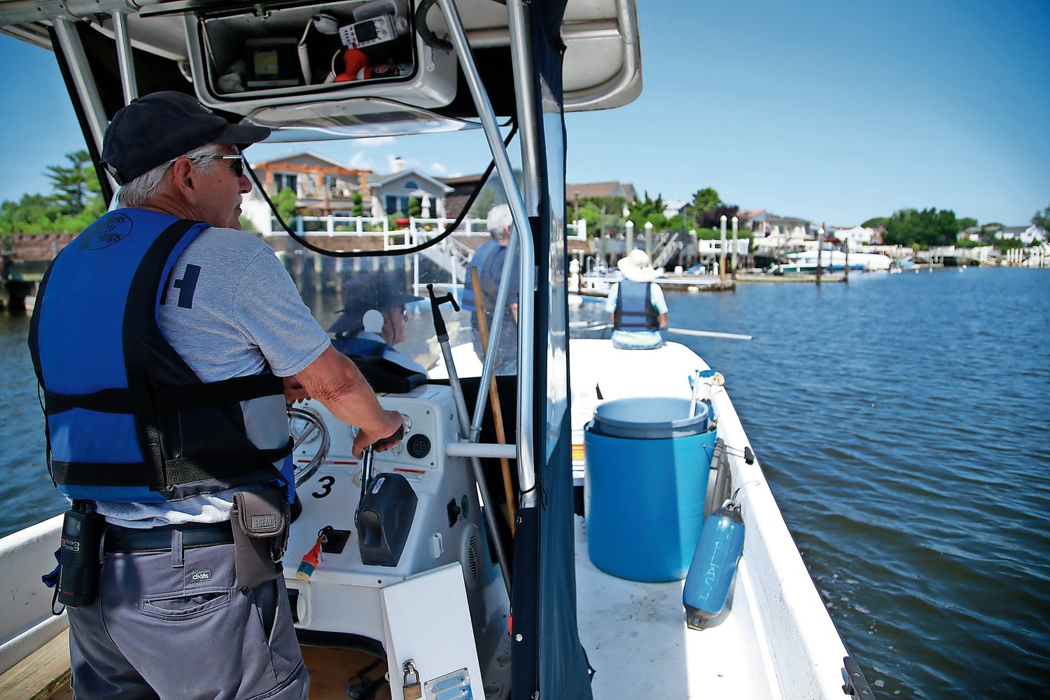 On every one of his patrols, Boat Captain Toporcer scans the waterways in search of floating debris.