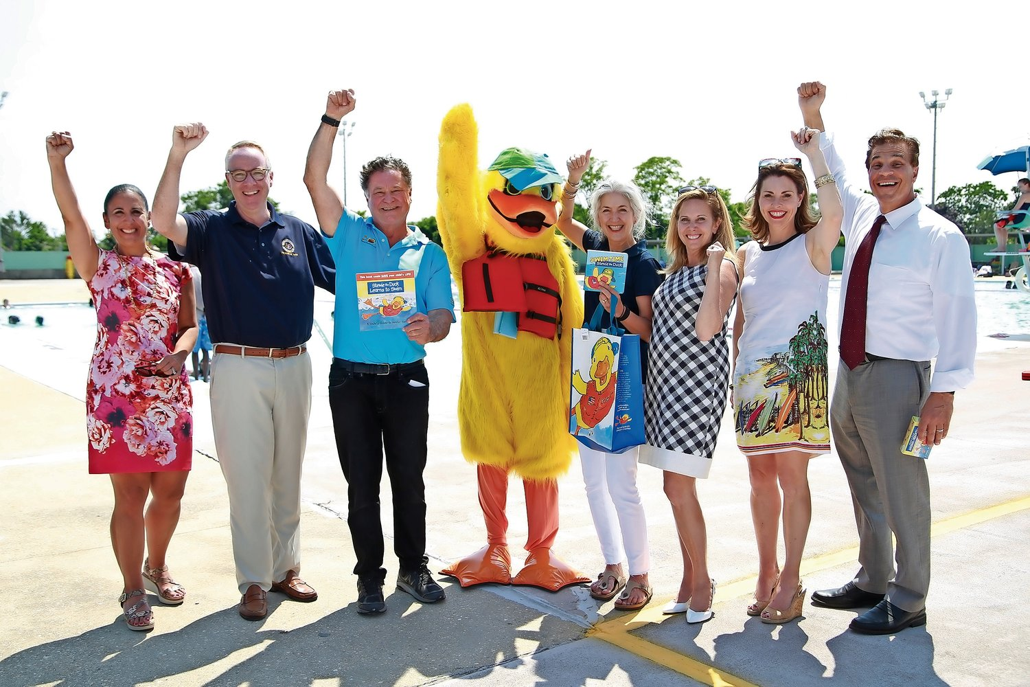 Hempstead officials, Stew and Kim Leonard and Stewie the Duck gathered at the Newbridge Road Park Pool on June 28 to promote pool safety.