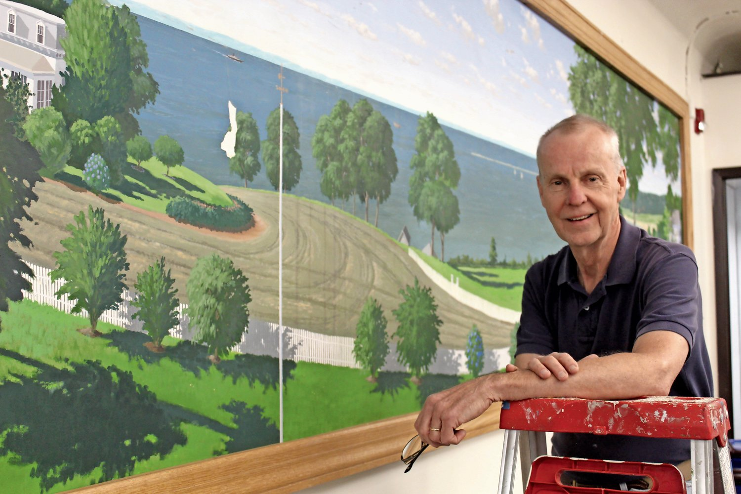 Sea Cliff resident Mark Fay is restoring the mural that he painted in Village Hall in 1993.