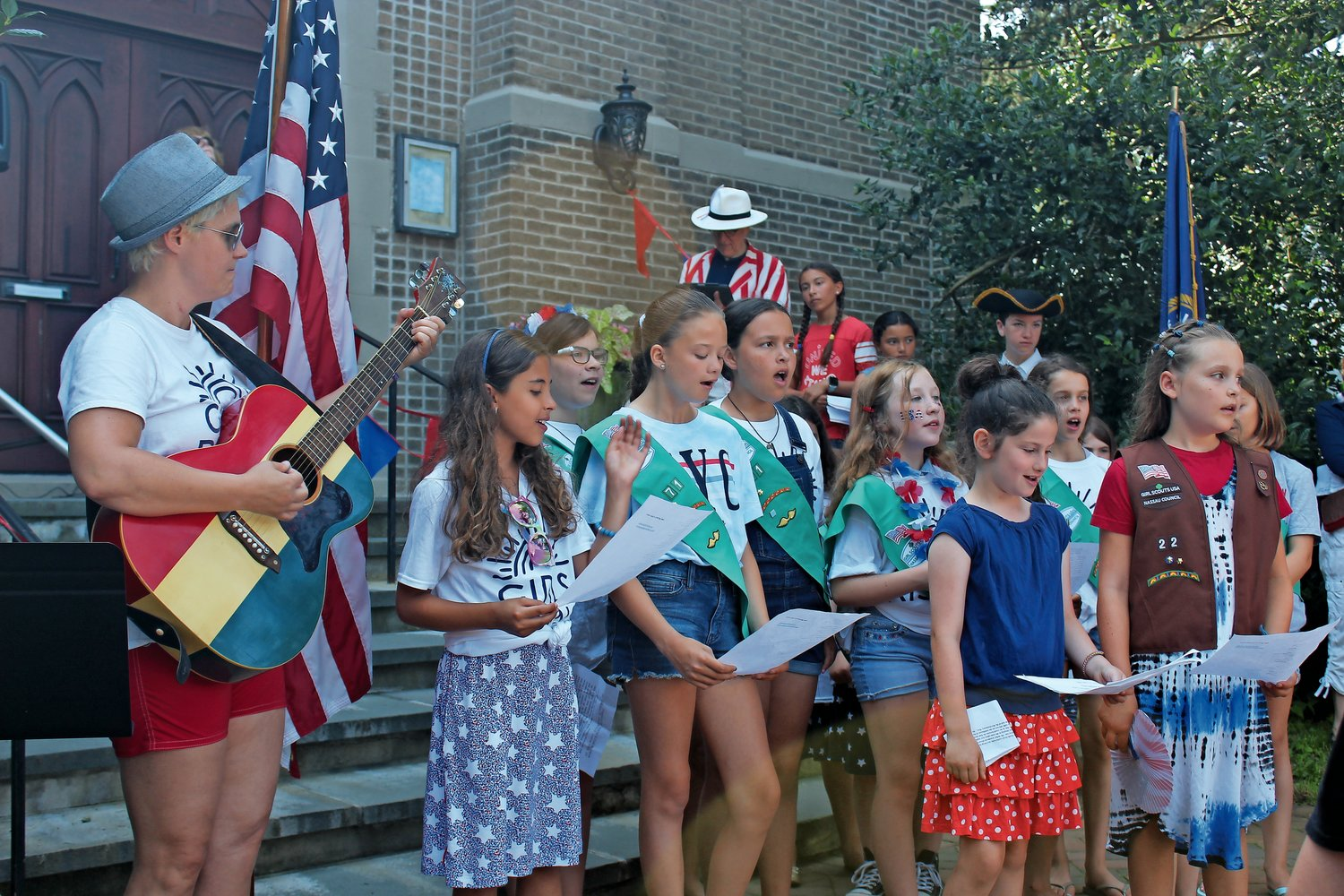 "Sea Cliff's Girl Scouts sang ""America the Beautiful,"" accompanied by Kristen Ellis-Henderson, far left, of Antigone Rising."