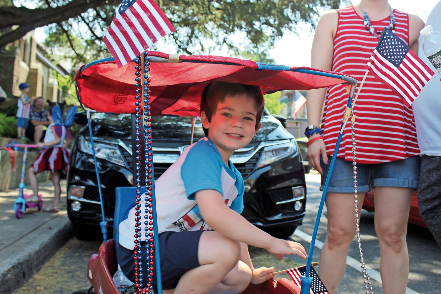 Evan D'Agostino, 4, arrived at Sea Cliff's Independence Day celebration in style in his wagon, which was decked out in American flags and colorful beads.