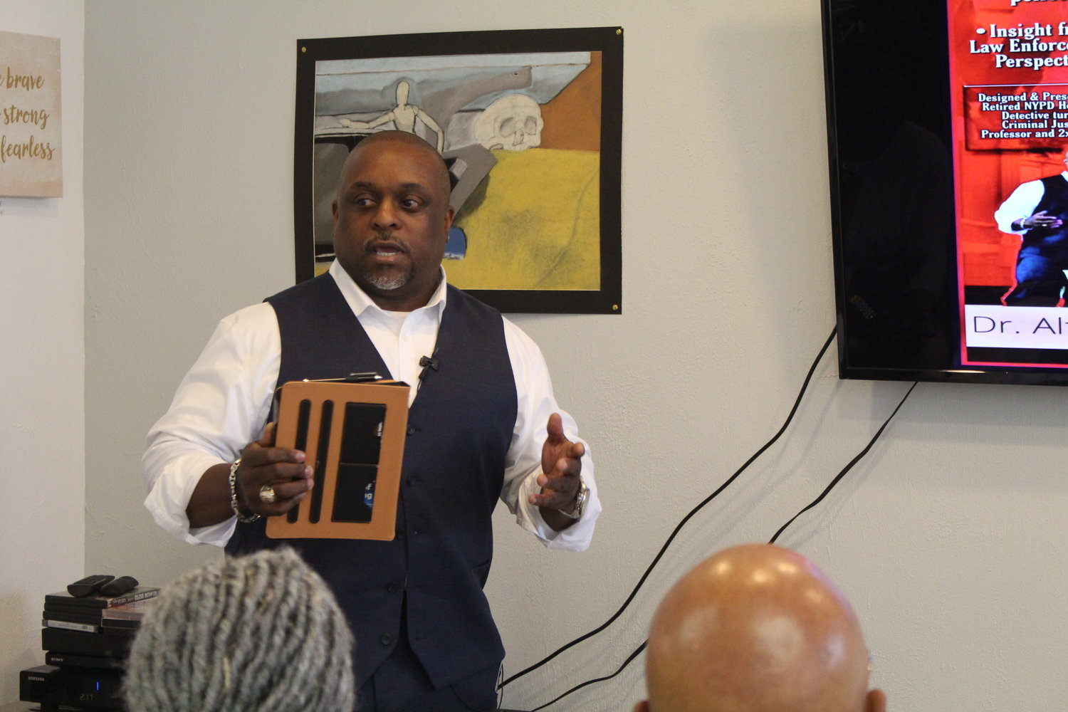 Dr. Alfred Titus, a former New York City Police Department homicide detective and hostage negotiator who is now an author and professor, shared tips on how to safely interact with police at an informational seminar on June 30 at 3D's Community Empowerment Center in Baldwin.