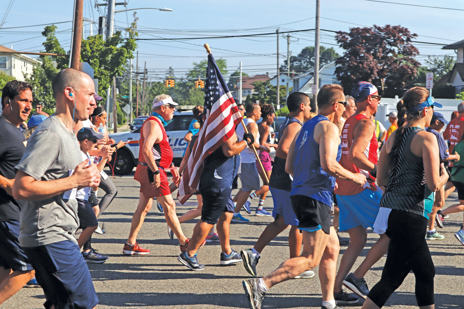 Peppered through the myriad of runners were glimpses of patriotic colors. One racer propped-up an American flag throughout the race.