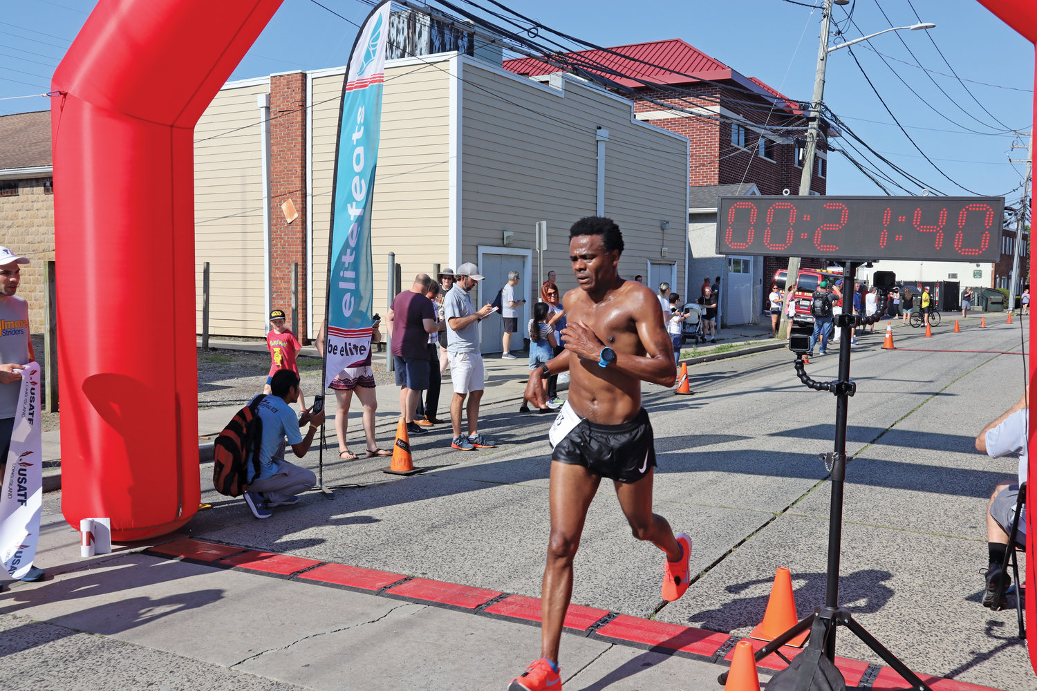 Male Masters first place winner Boyd Carrington, of Amityville, crossed the finish line.