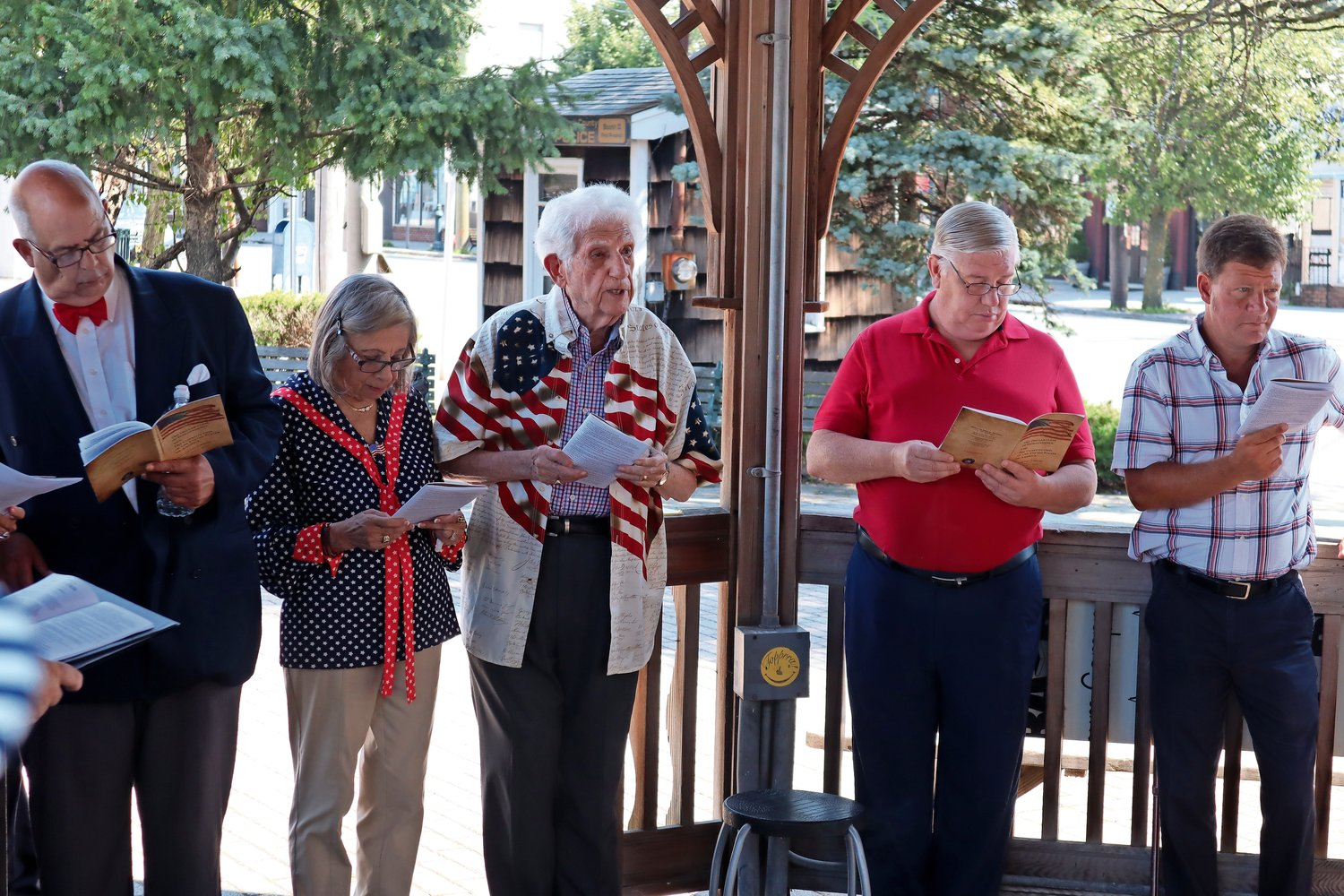 Adrienne and Lawrence Garfinkel, second and third from the left, host the annual Declaration of Independence reading in the gazebo. Joining them were Merrick Chorale leader Herbert Bradensten, Mike Reid and Dave Denenberg.
