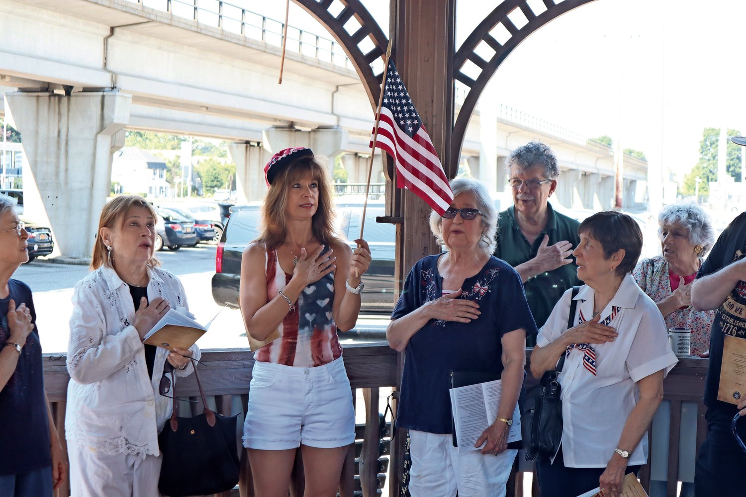Before beginning the reading, Merokeans recited the Pledge of Allegiance as Margaret Biegelman, member of the Merrick Chamber of Commerce, held the flag.
