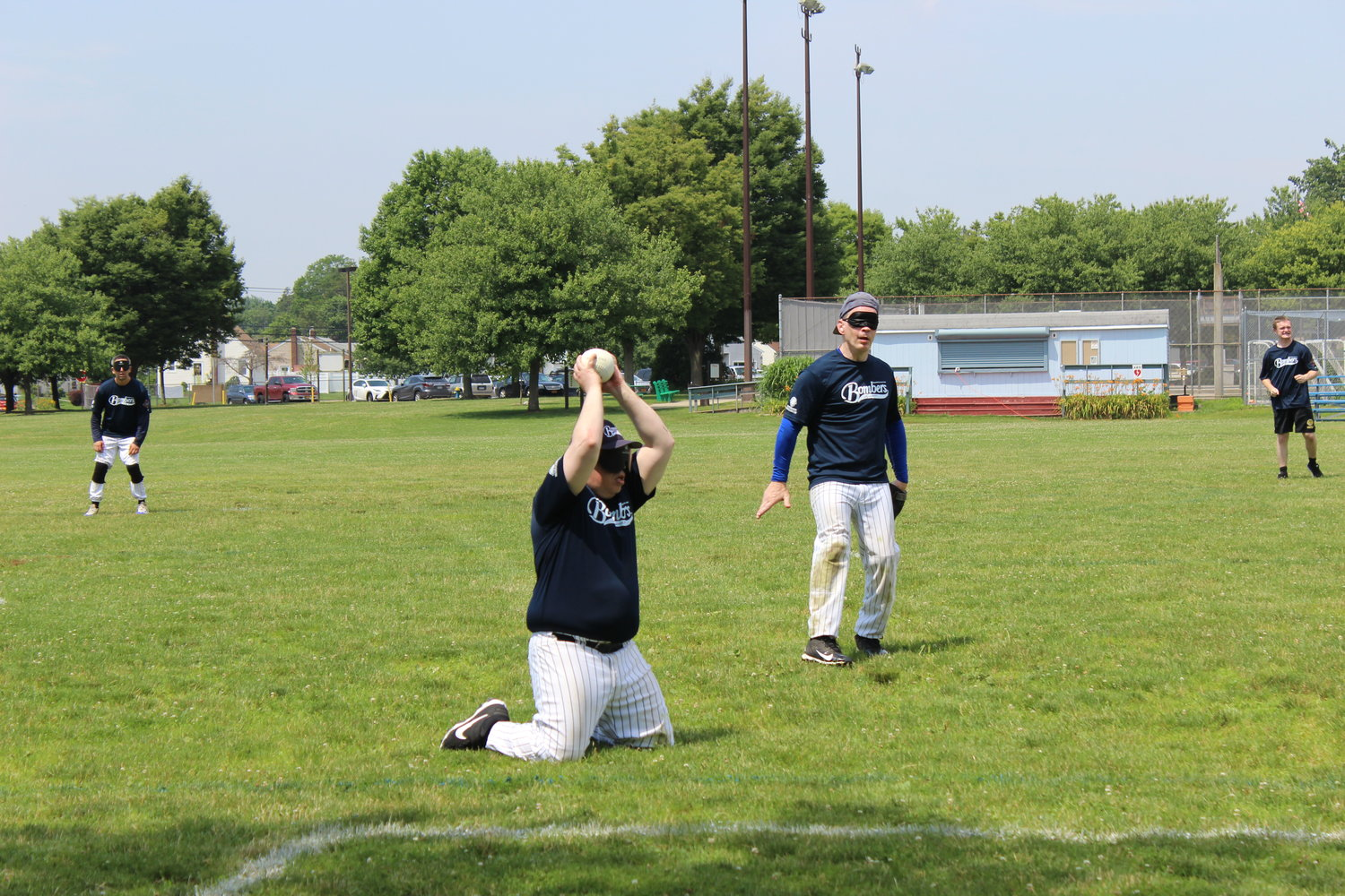 The Long Island Bombers beep baseball team hosted the annual Long Island Classic tournament at Senator Speno Memorial Park on June 29. Above, Edgar Erickson, of Manhattan, recorded an out by grabbing the ball before the batter reached base.