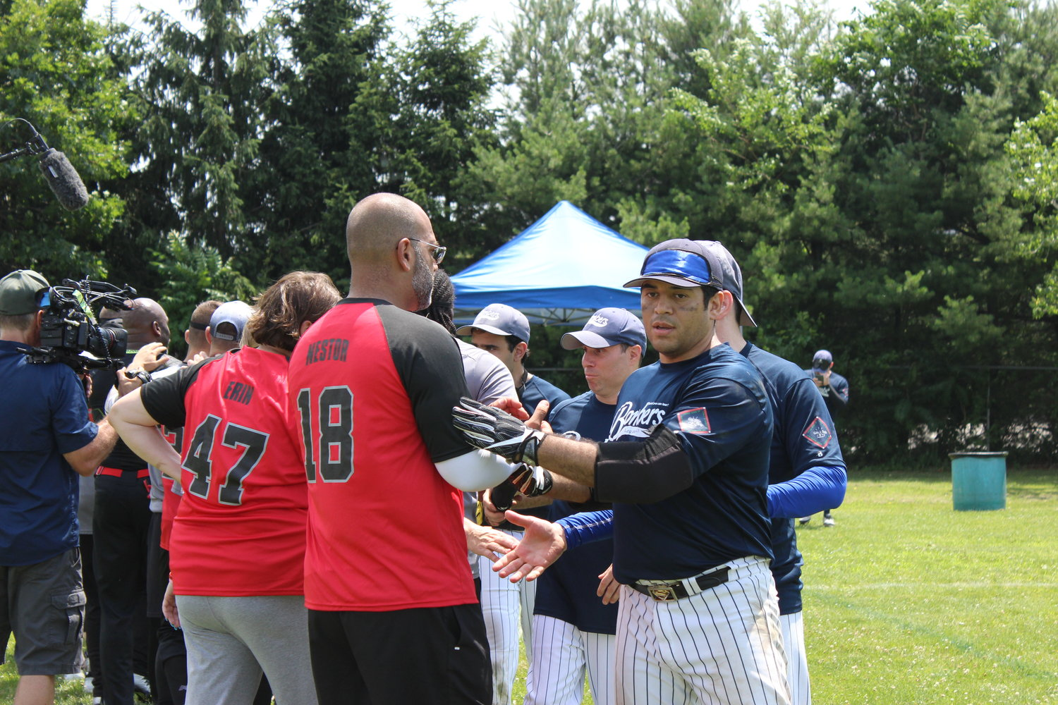 The Long Island Bombers, led by Captain Alex Barrera, of Bayshore, lined up to high-five the New Jersey Titans after their game.