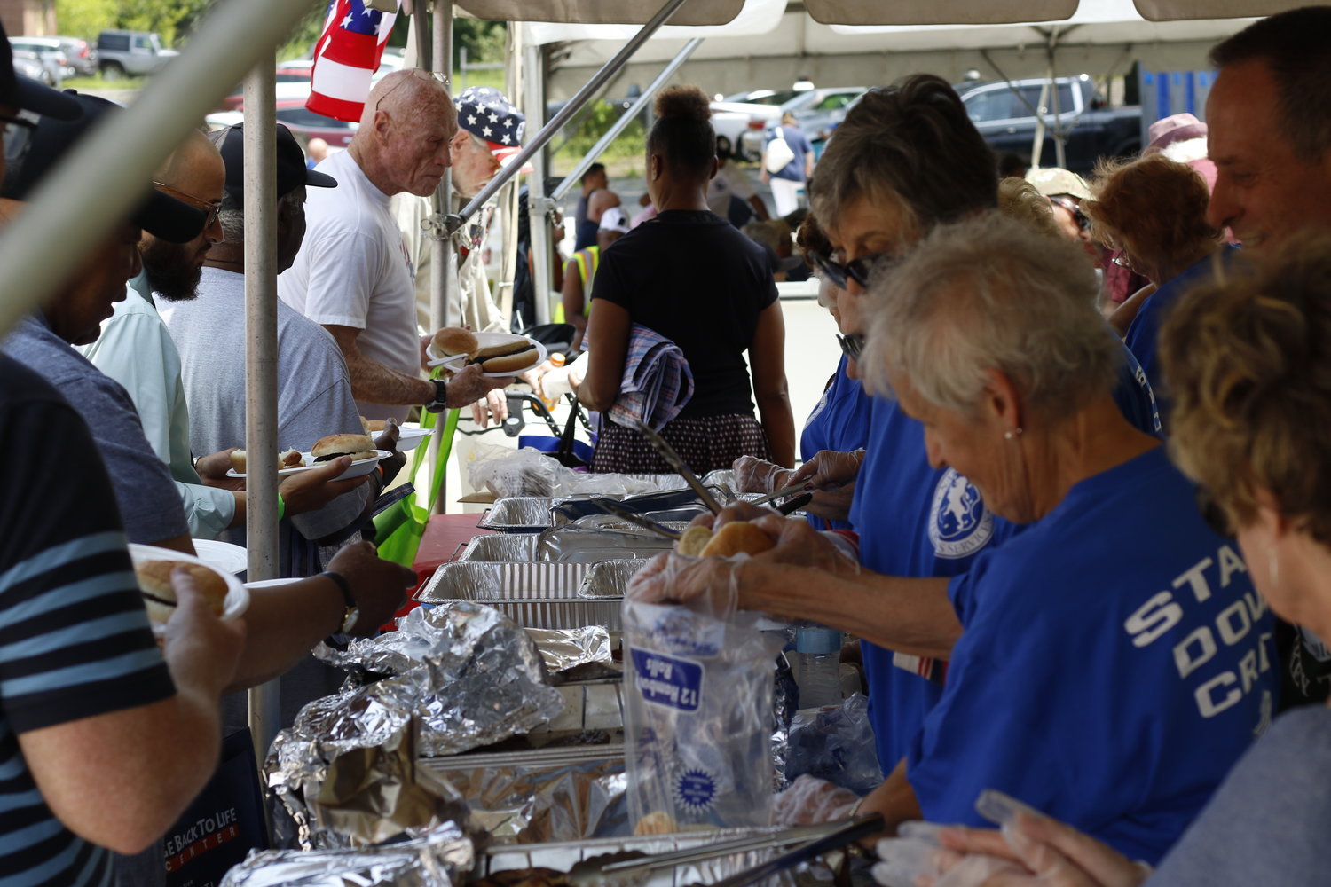 A barbecue was staffed by volunteers who called themselves the Stand Down Crew.