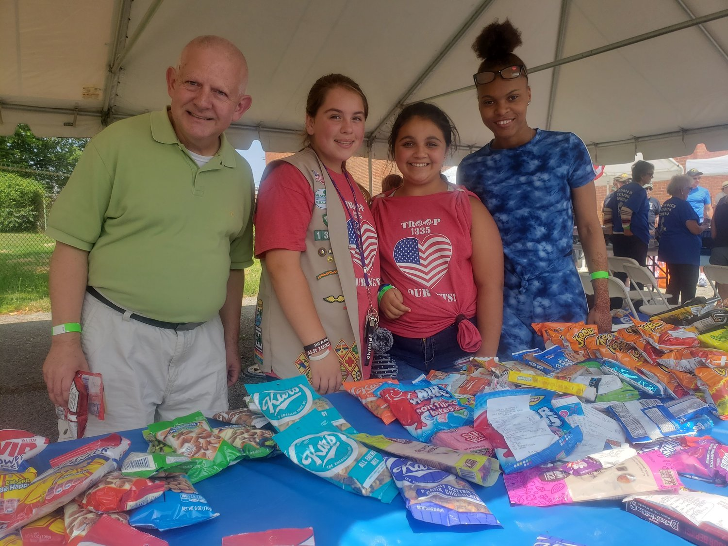Elmont Girl Scout Troop 1335 and Freeport AHRC Nassau volunteers, from left, Ralph Gilloon, Natalie Becker, Sammy Vacchian and Neffertiti Dolce.